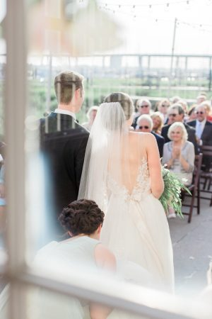 Wedding ceremony at The Historic Rice Mill in Charleston.