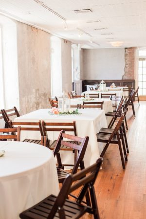 Light filled reception at The Historic Rice Mill in Charleston.