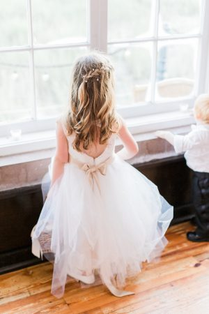 Tulle flower girl dress at The Historic Rice Mill in Charleston.
