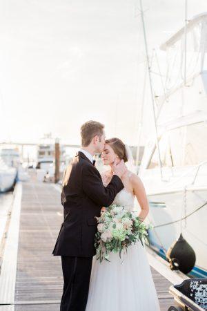 Romantic sunset bridal portraits at the Charleston Marina against the sail boats.