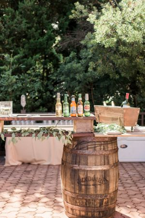Summer wedding bar with beer and greenery at The Mill at Yellow River.