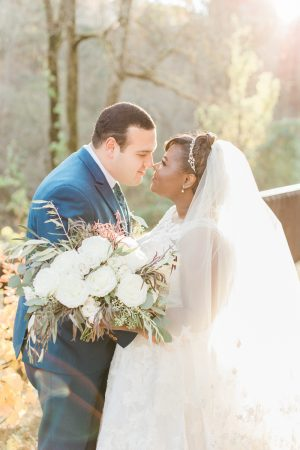 Sunset wedding bridal portraits at Ivy Hall at Roswell Mill. All white wedding bouquet.
