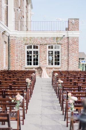 Outdoor ceremony at The Historic Rice Mill in Charleston with a view of the Charleston Marina.