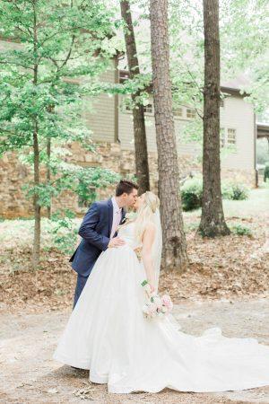 Bride and groom kissing portrait. Atlanta fine art wedding photographer.