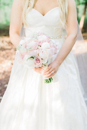 Silk satin sweetheart cut wedding dress and pink wedding bouquet.