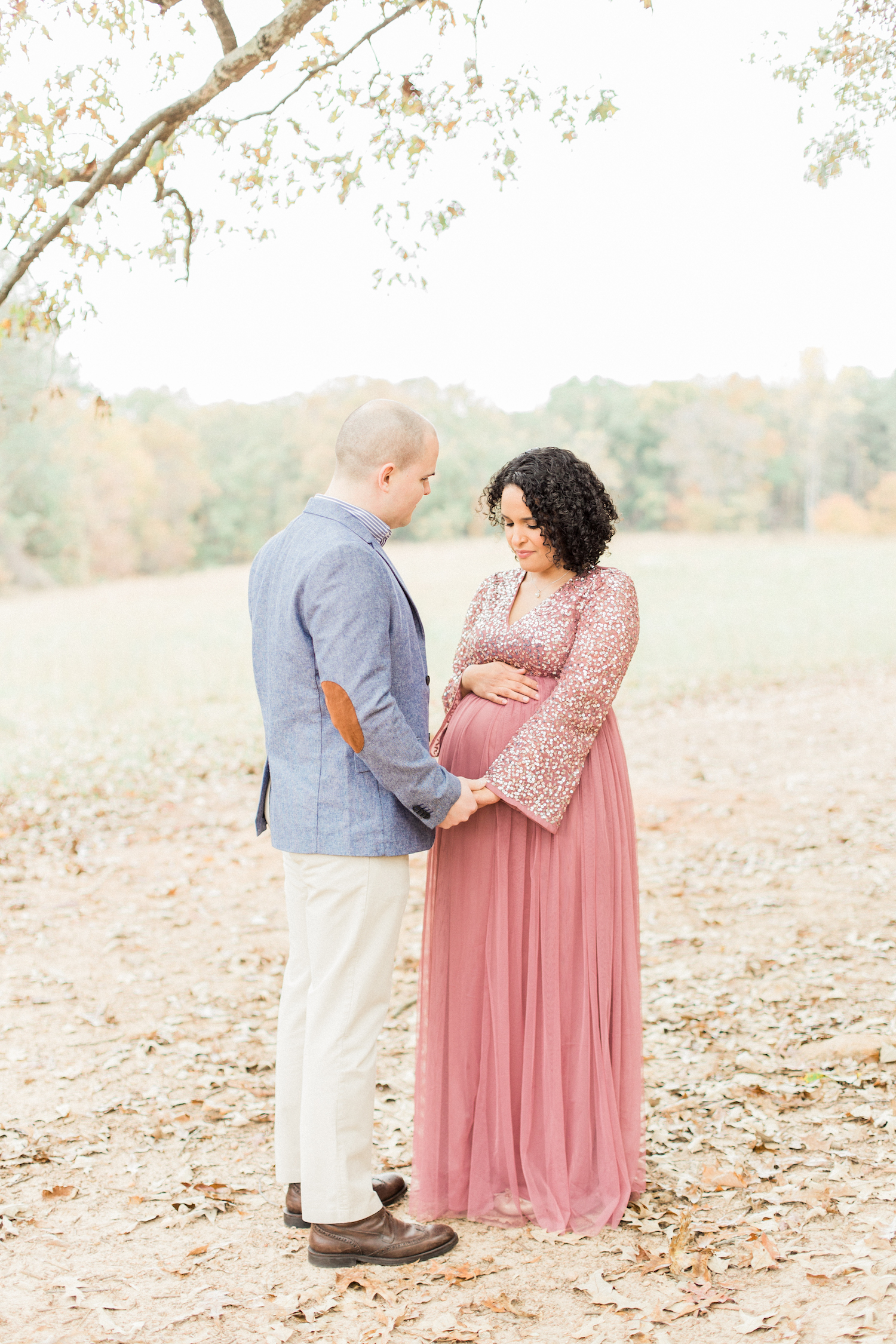 Maternity session style. Blue sports coat with elbow patch. Sparkly tulle mauve maternity dress from ASOS. Atlanta Fine Art Maternity Photographer.
