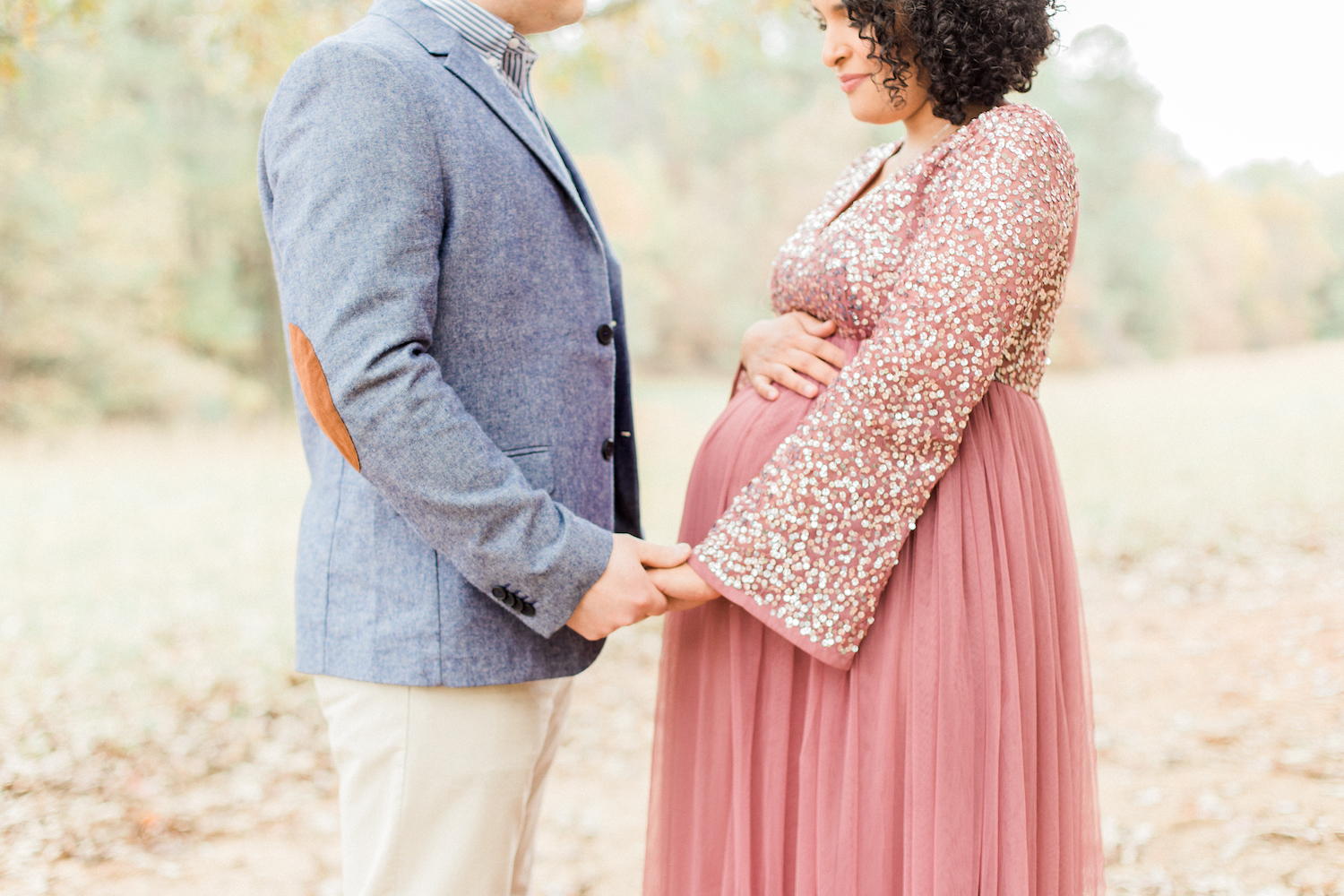 Romantic belly photo holding hands maternity session. Sparkly tulle maternity dress. Maternity session style. Atlanta Fine Art Maternity Photographer.