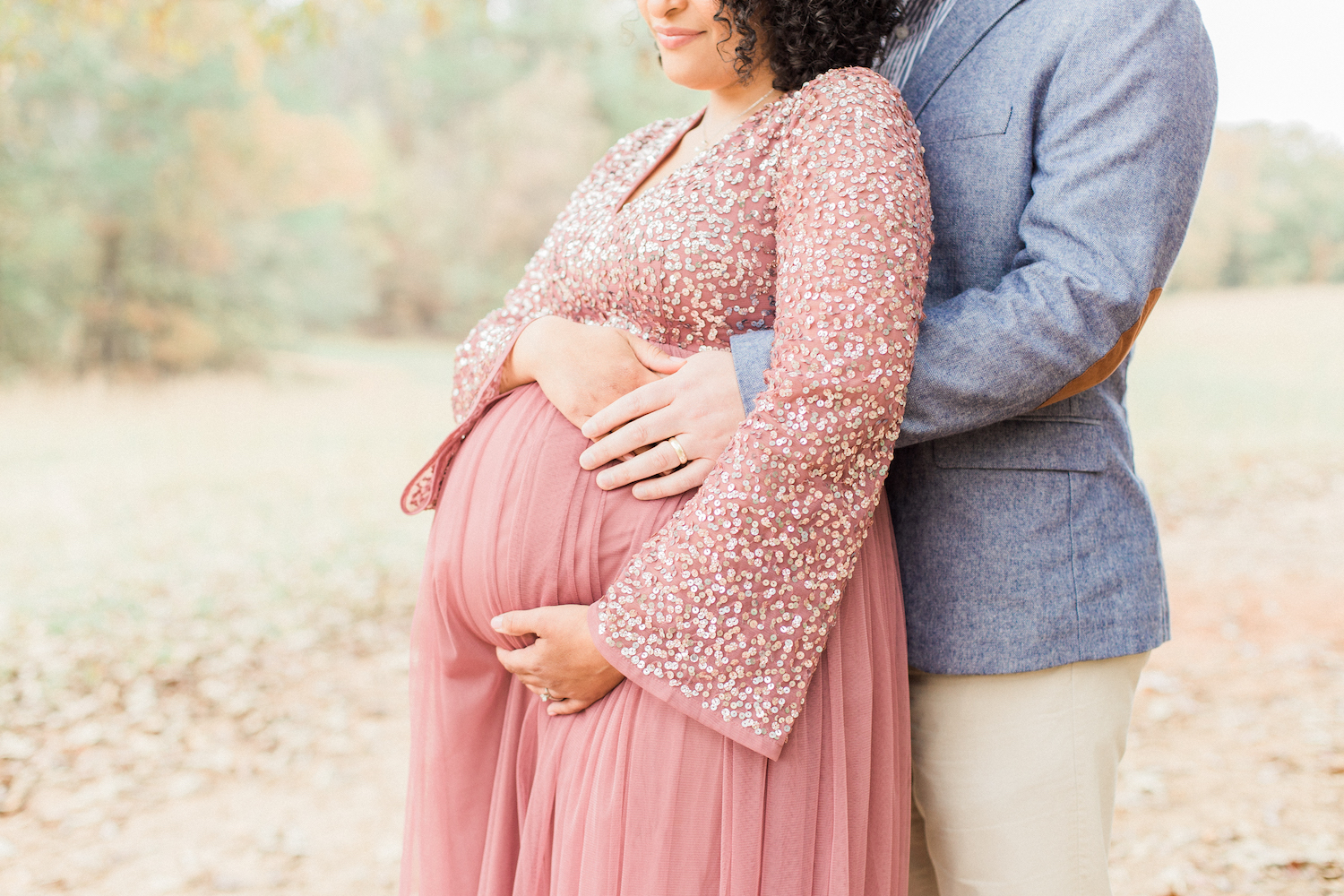 Belly and wedding rings photo romantic maternity session. Sparkly tulle mauve maternity dress. Atlanta Fine Art Maternity Photographer.