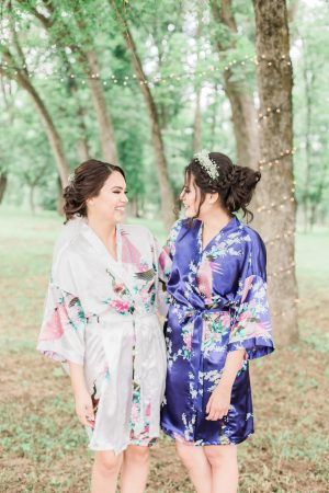 Bride and best friend getting ready photo in silk robes.