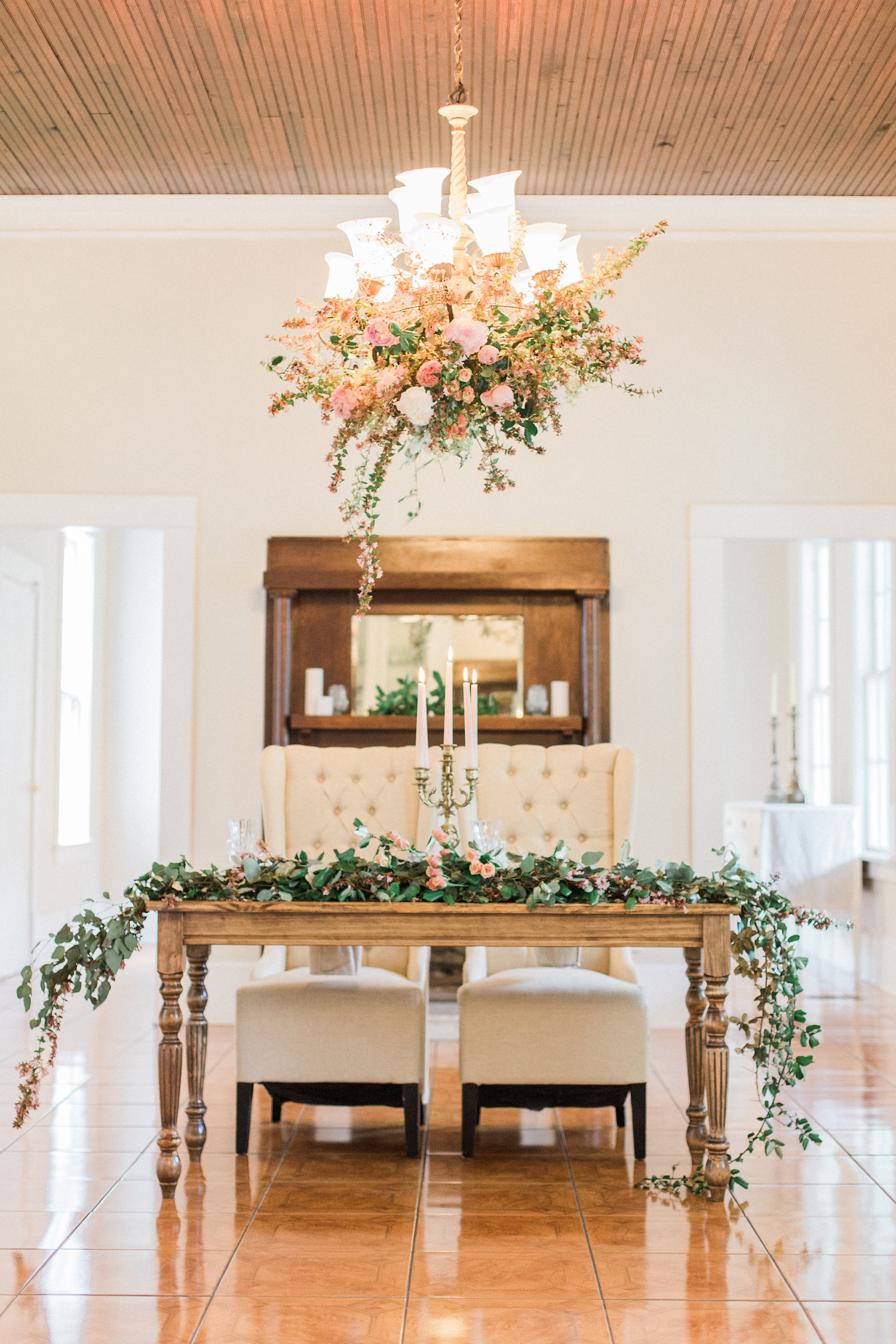 Floral styling on a chandelier for sweetheart table at The McGarity House in Temple, Georgia.
