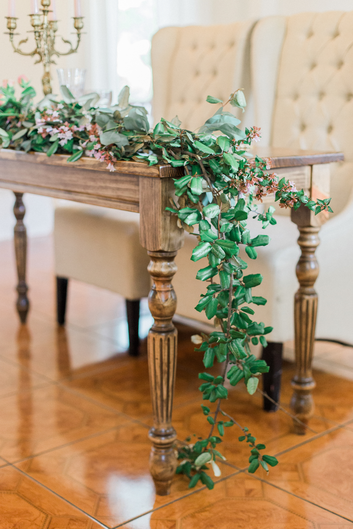 Floral garland for sweetheart table at a wedding at The McGarity House.