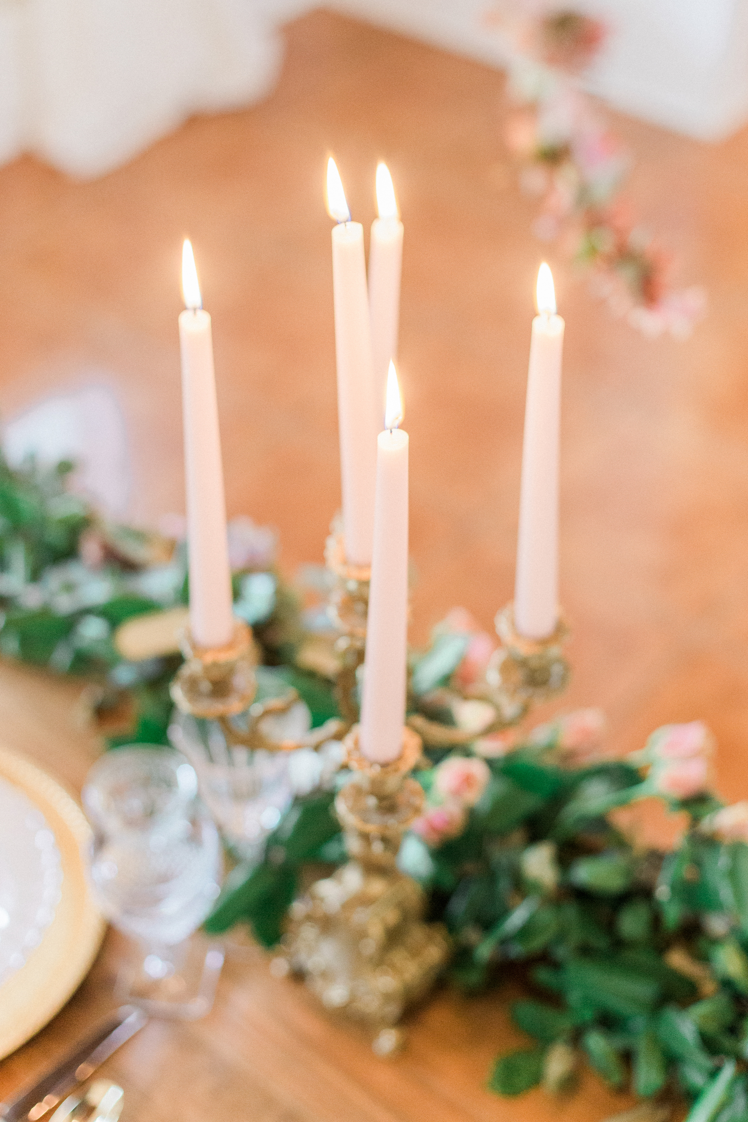 Fine art wedding photographer. Sweetheart table centerpiece. Candelabra.