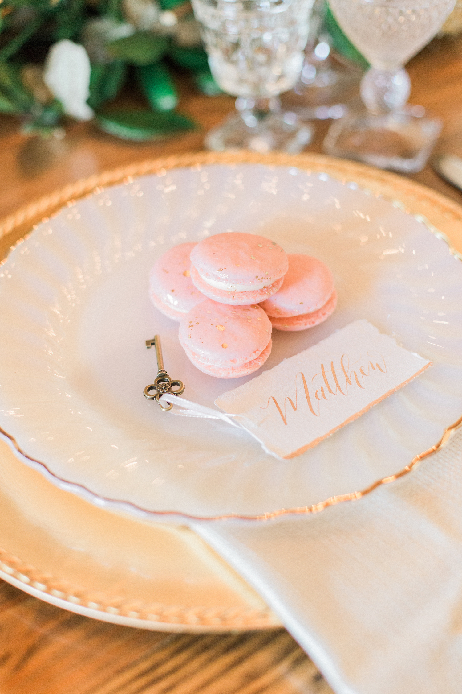 Pink gold accented wedding macaroons. Key and calligraphy place cards for table settings on a sweetheart table.