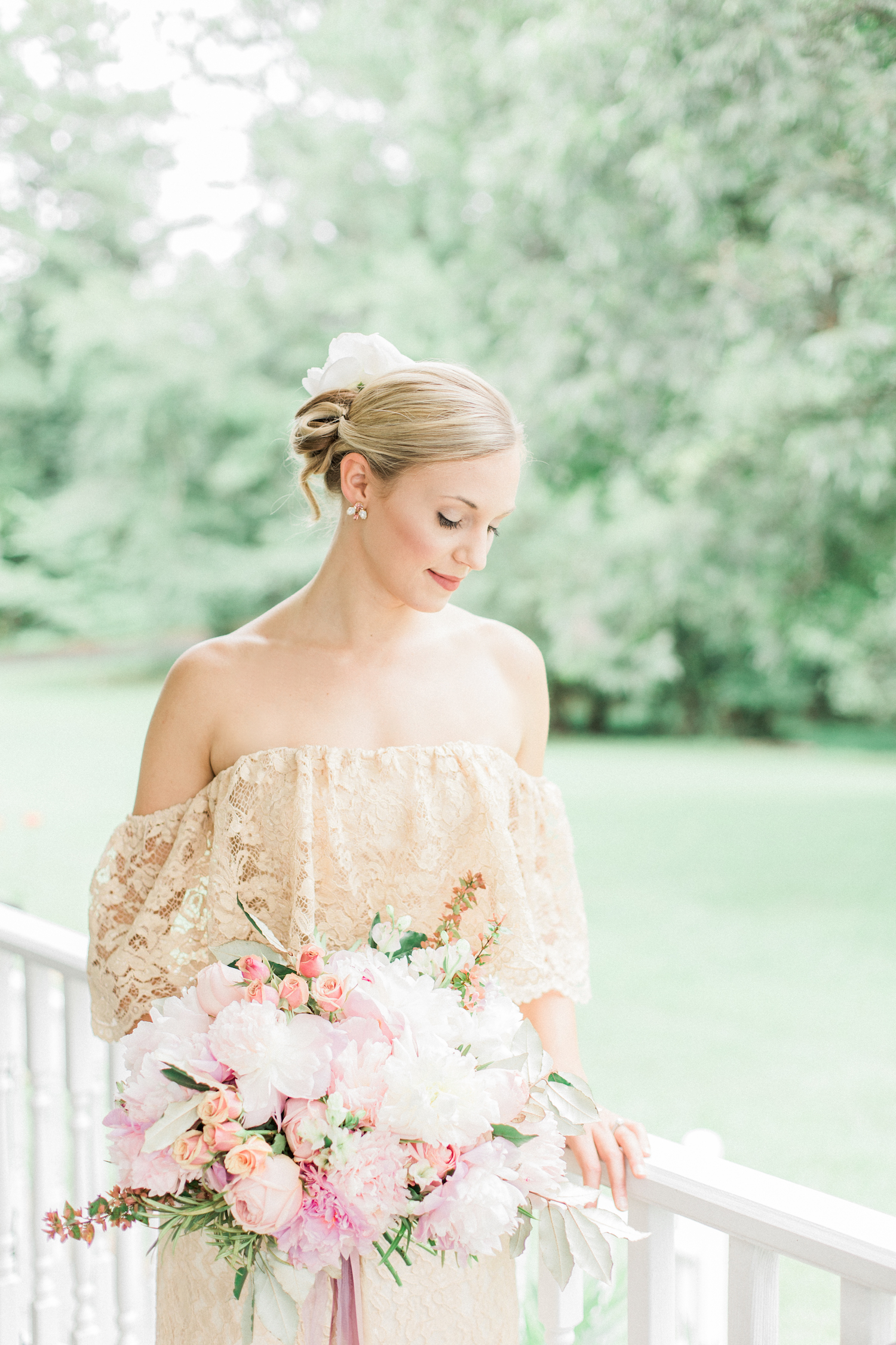 Gold off shoulder lace bohemian wedding dress. Blush wedding bouquet with peonies, dahlias, and roses.