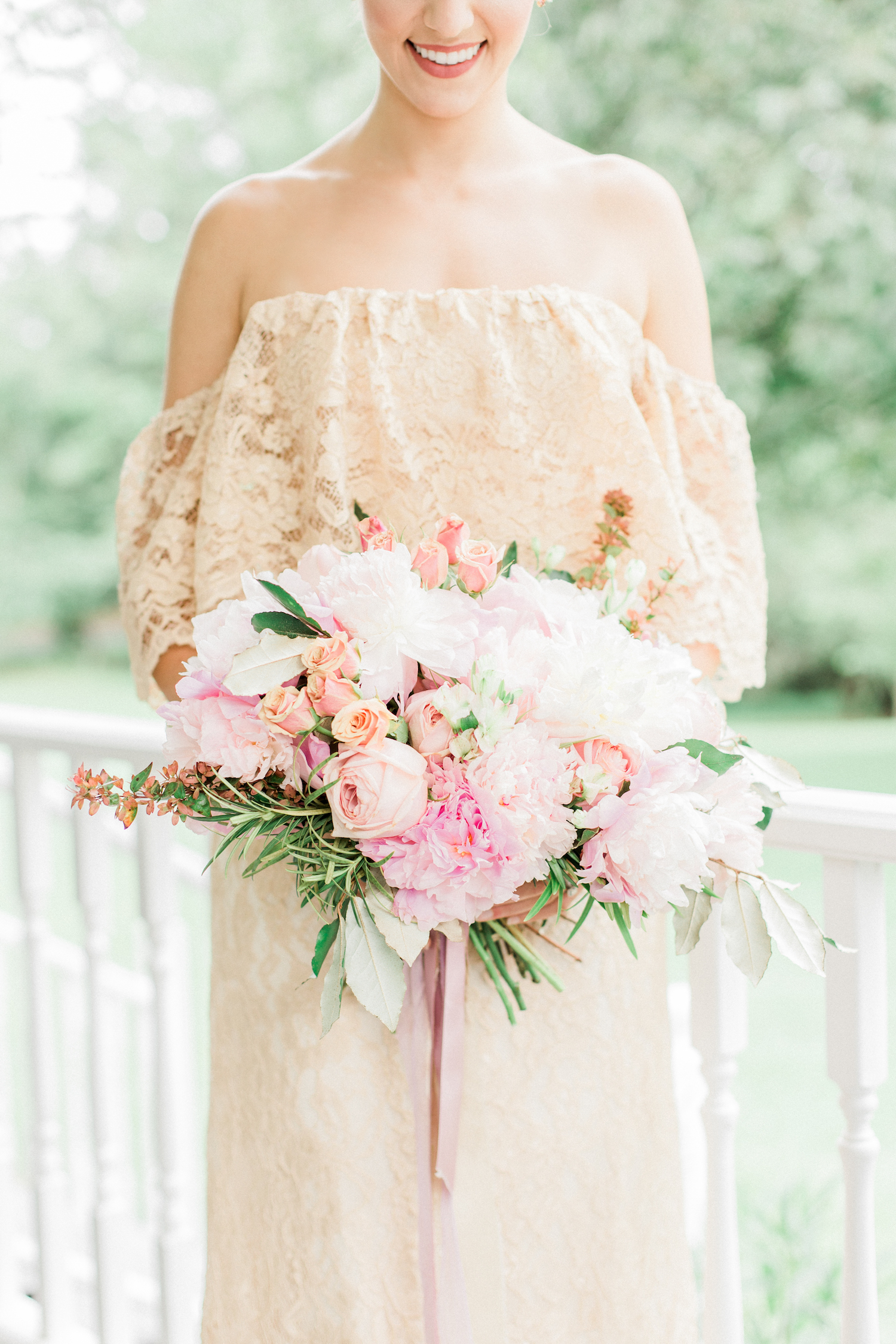 Beautiful pink mauve and blush wedding bouquet with peonies and roses.