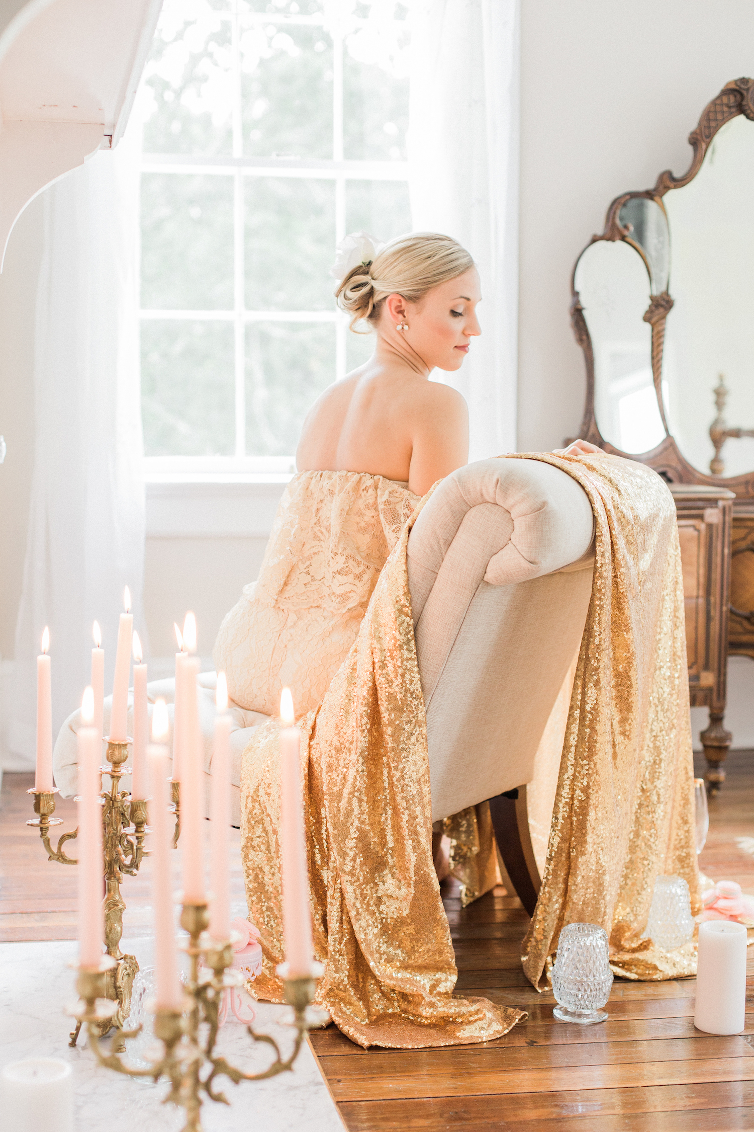 Sparkly glittery gold getting ready room with candelabras. Gold lace off shoulder wedding dress.