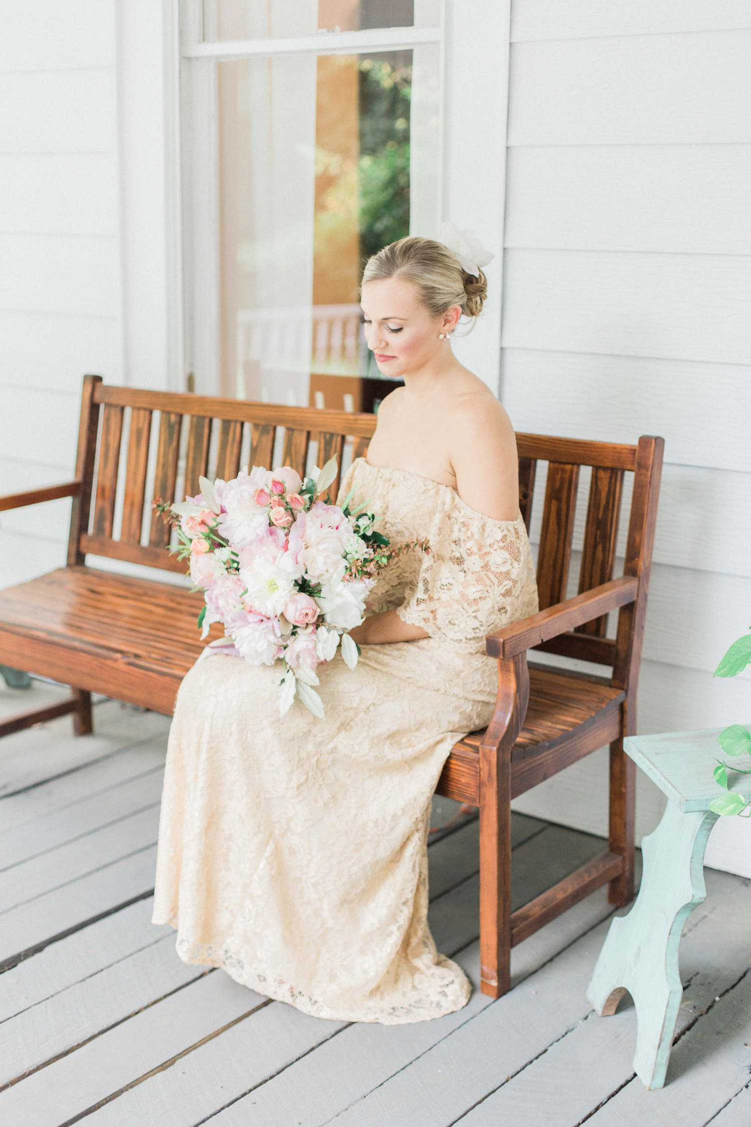 Wrap around porch wedding. Gold lace off shoulder wedding dress with bridal undo hairstyle.