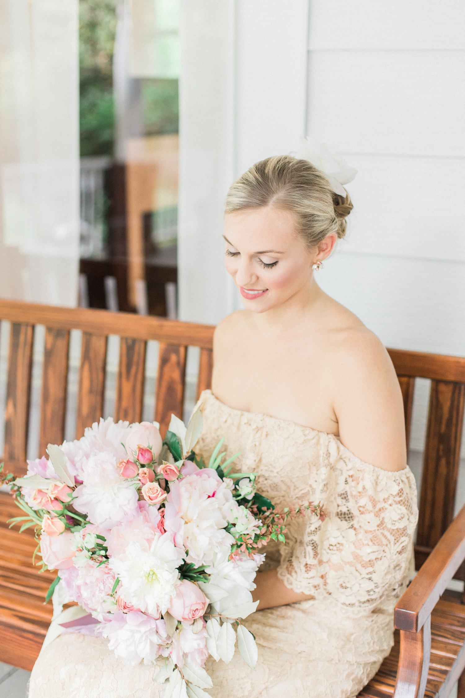 Pink mauve blush wedding bouquet. Off shoulder gold and lace wedding dress.