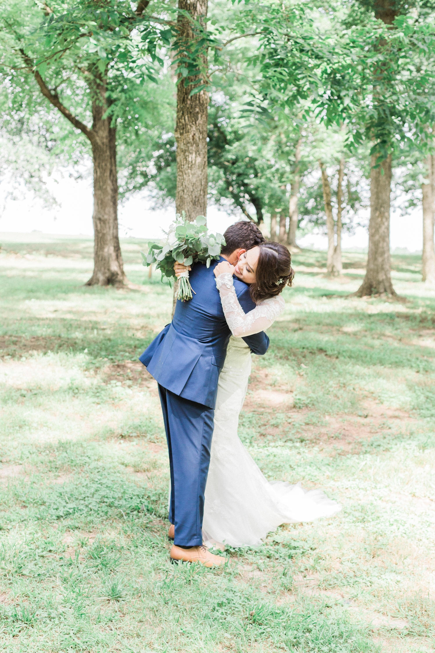 First look. Summer, outdoor, barn wedding in north Georgia at Hays McDonald Farm in Jefferson, Georgia. Photo by Kesia Marie Photography- Fine Art Wedding Photographer.