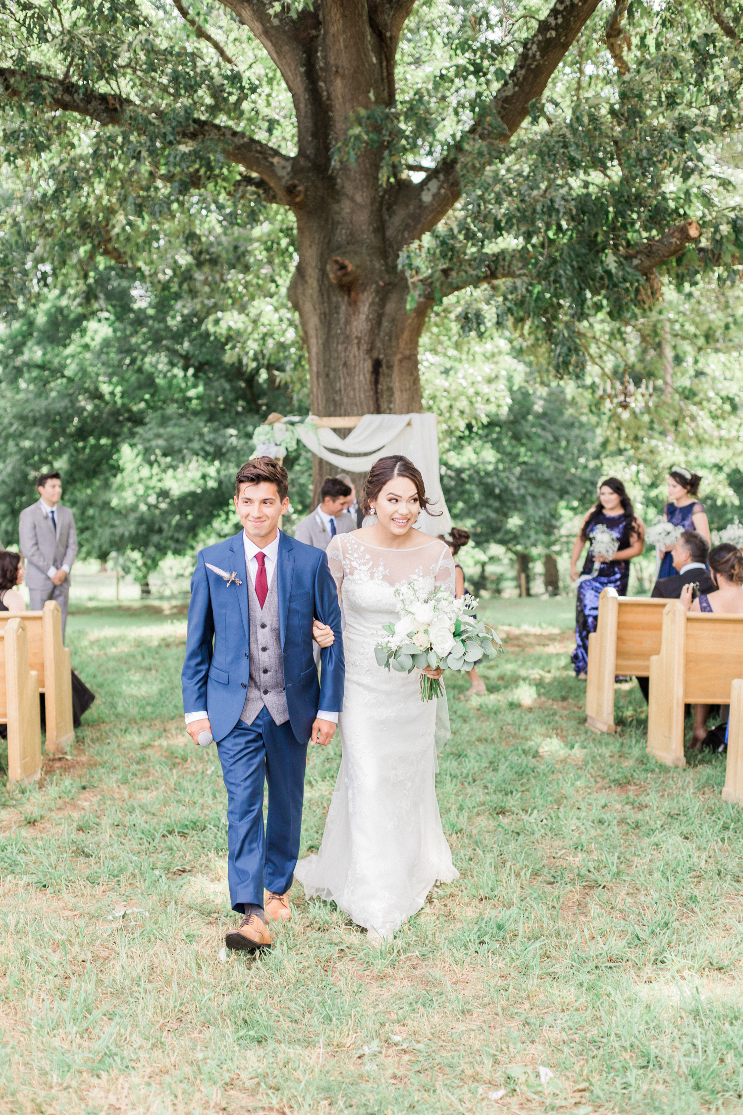Walking back down the aisle as husband and wife. Summer, outdoor, barn wedding in north Georgia at Hays McDonald Farm in Jefferson, Georgia. Photo by Kesia Marie Photography - Fine Art Wedding Photographer.
