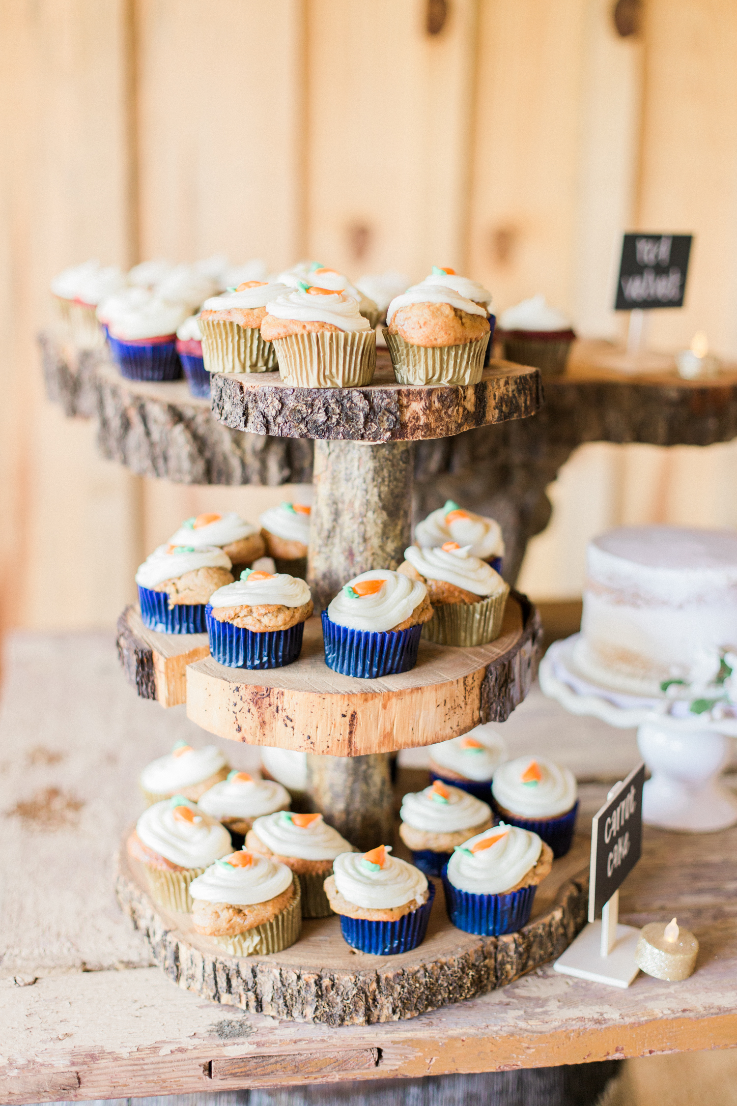 Cup cake tower on a rustic display. Summer, outdoor, barn wedding in north Georgia at Hays McDonald Farm in Jefferson, Georgia. Photo by Kesia Marie Photography - Fine Art Wedding Photographer.