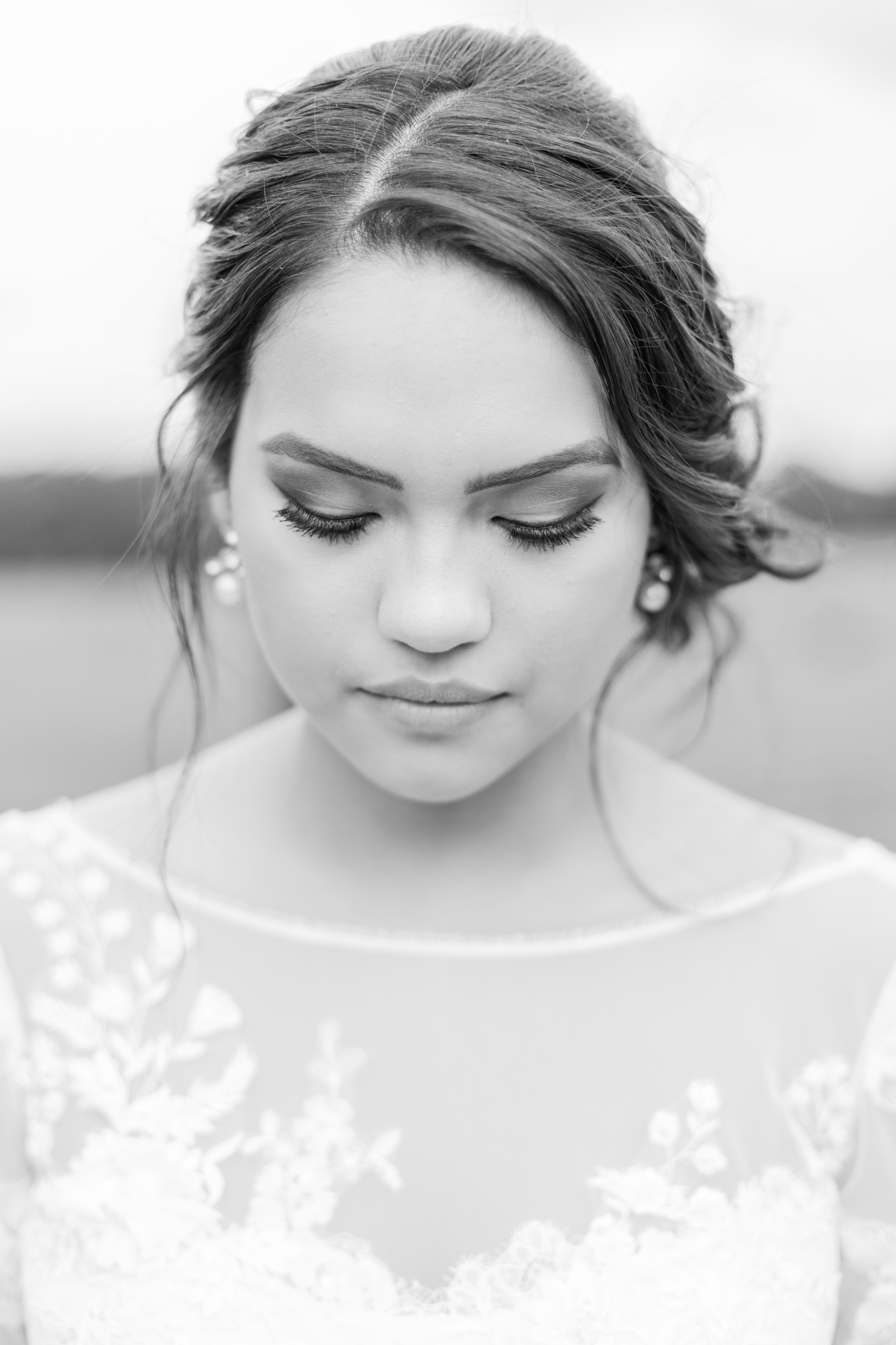 Black and white bridal portrait wearing a David's Bridal long sleeved lace dress. Summer, outdoor, barn wedding in north Georgia at Hays McDonald Farm in Jefferson, Georgia. Photo by Kesia Marie Photography - Fine Art Wedding Photographer.