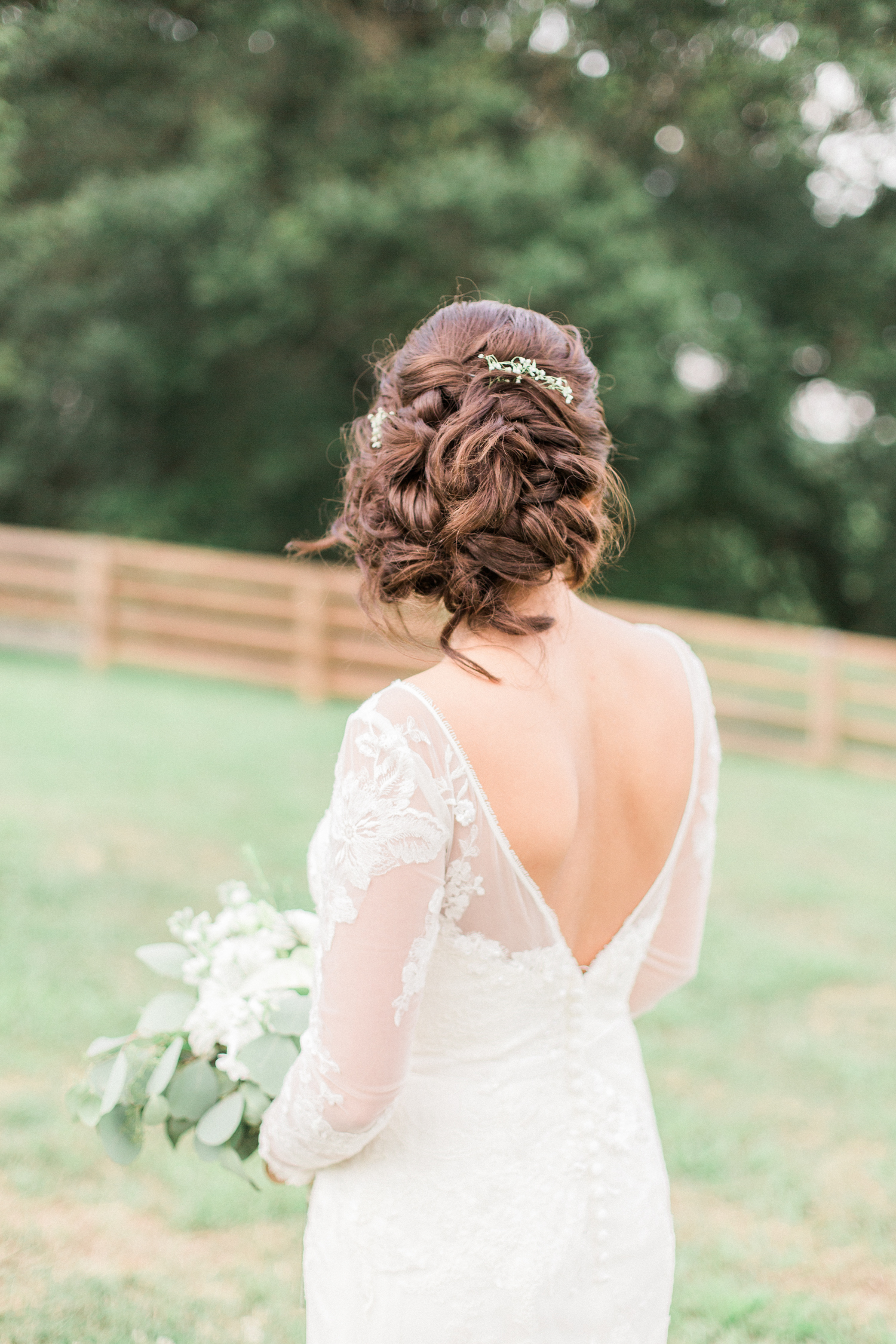 David's Bridal long sleeved lace wedding dress with an open back. Summer, outdoor, barn wedding in north Georgia at Hays McDonald Farm in Jefferson, Georgia. Photo by Kesia Marie Photography - Fine Art Wedding Photographer.