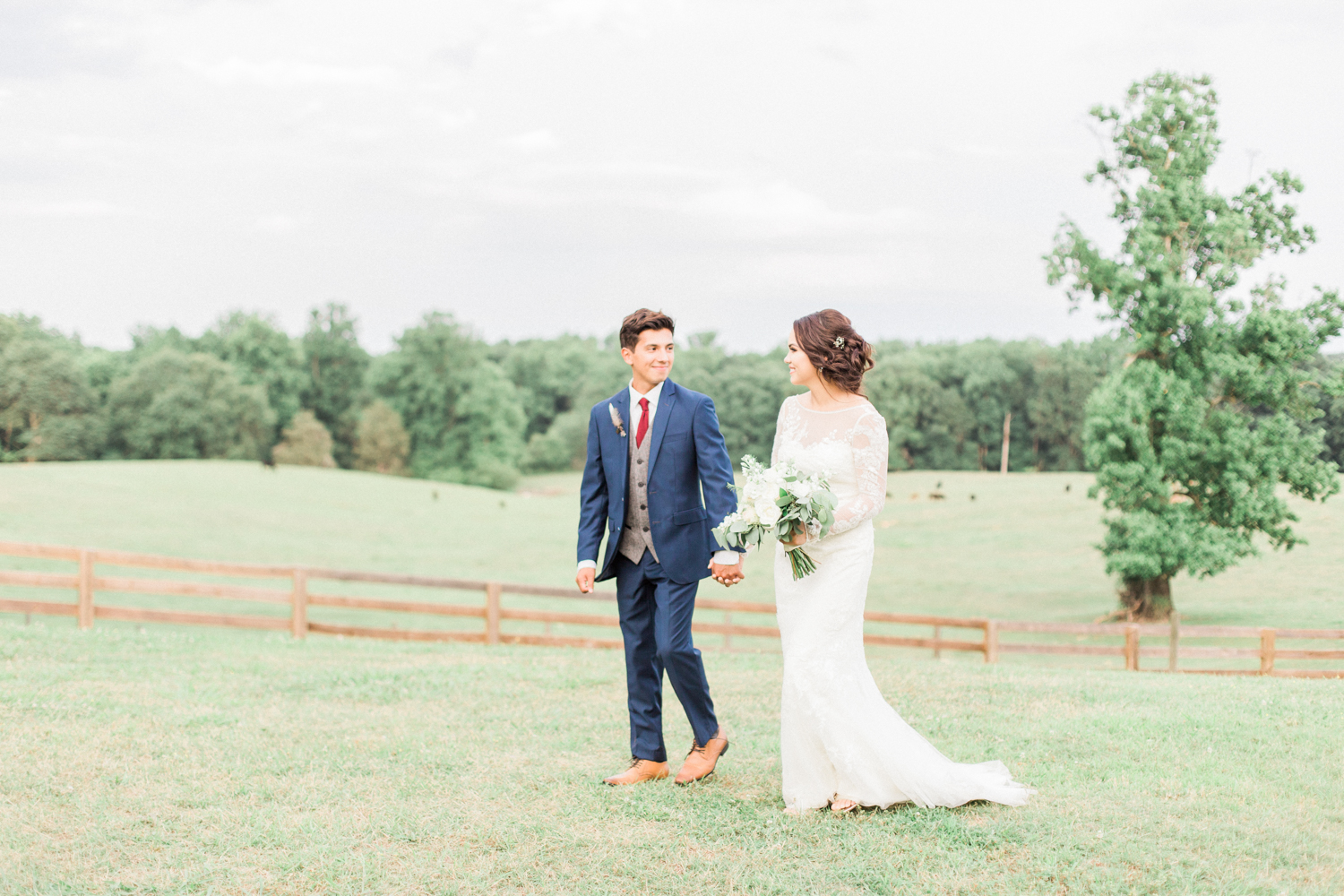 David's Bridal long sleeved lace wedding gown. Summer, outdoor, barn wedding in north Georgia at Hays McDonald Farm in Jefferson, Georgia. Photo by Kesia Marie Photography - Fine Art Wedding Photographer.