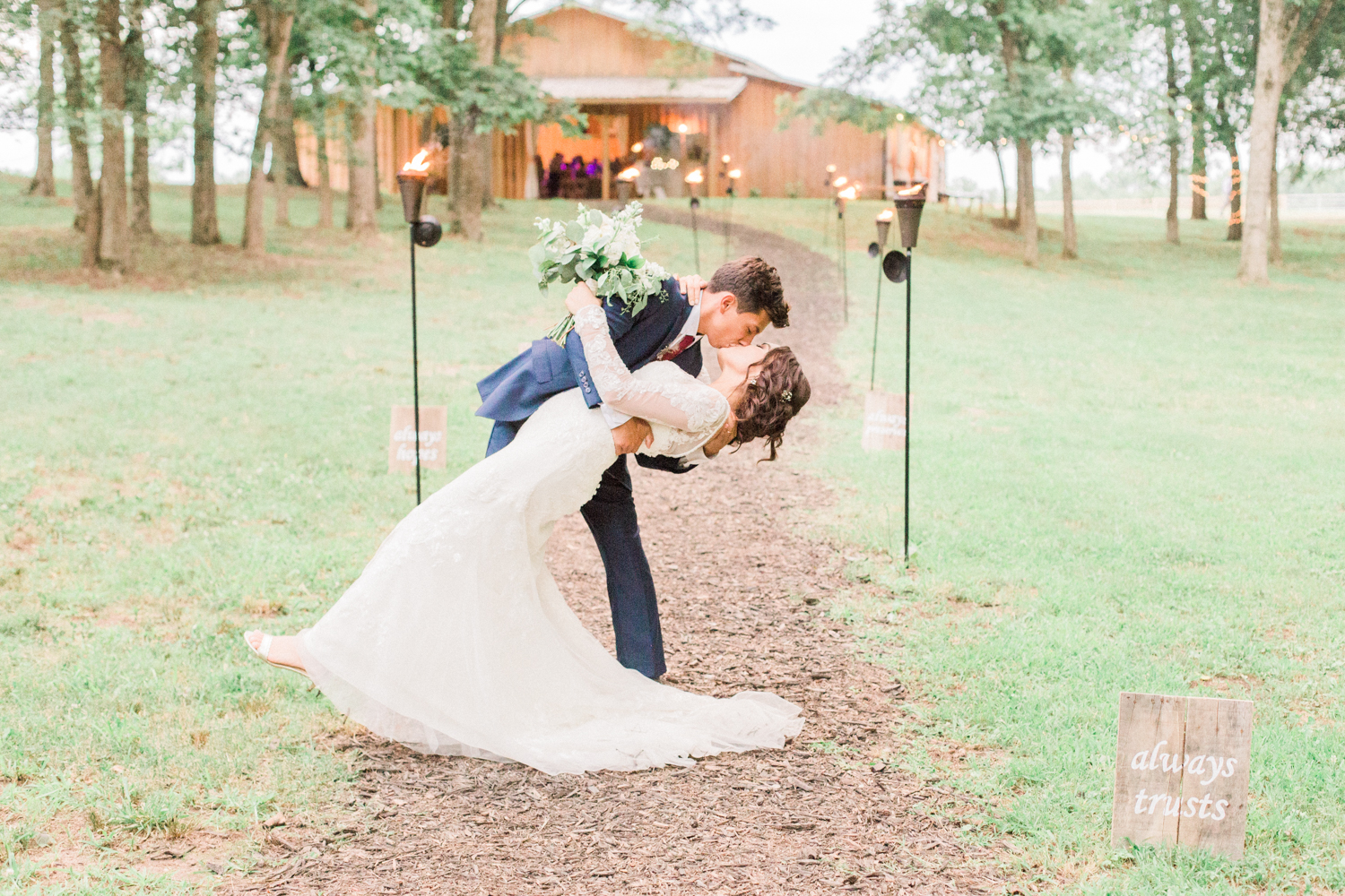 Bride and groom sharing a kiss. Summer, outdoor, barn wedding in north Georgia at Hays McDonald Farm in Jefferson, Georgia. Photo by Kesia Marie Photography - Fine Art Wedding Photographer.