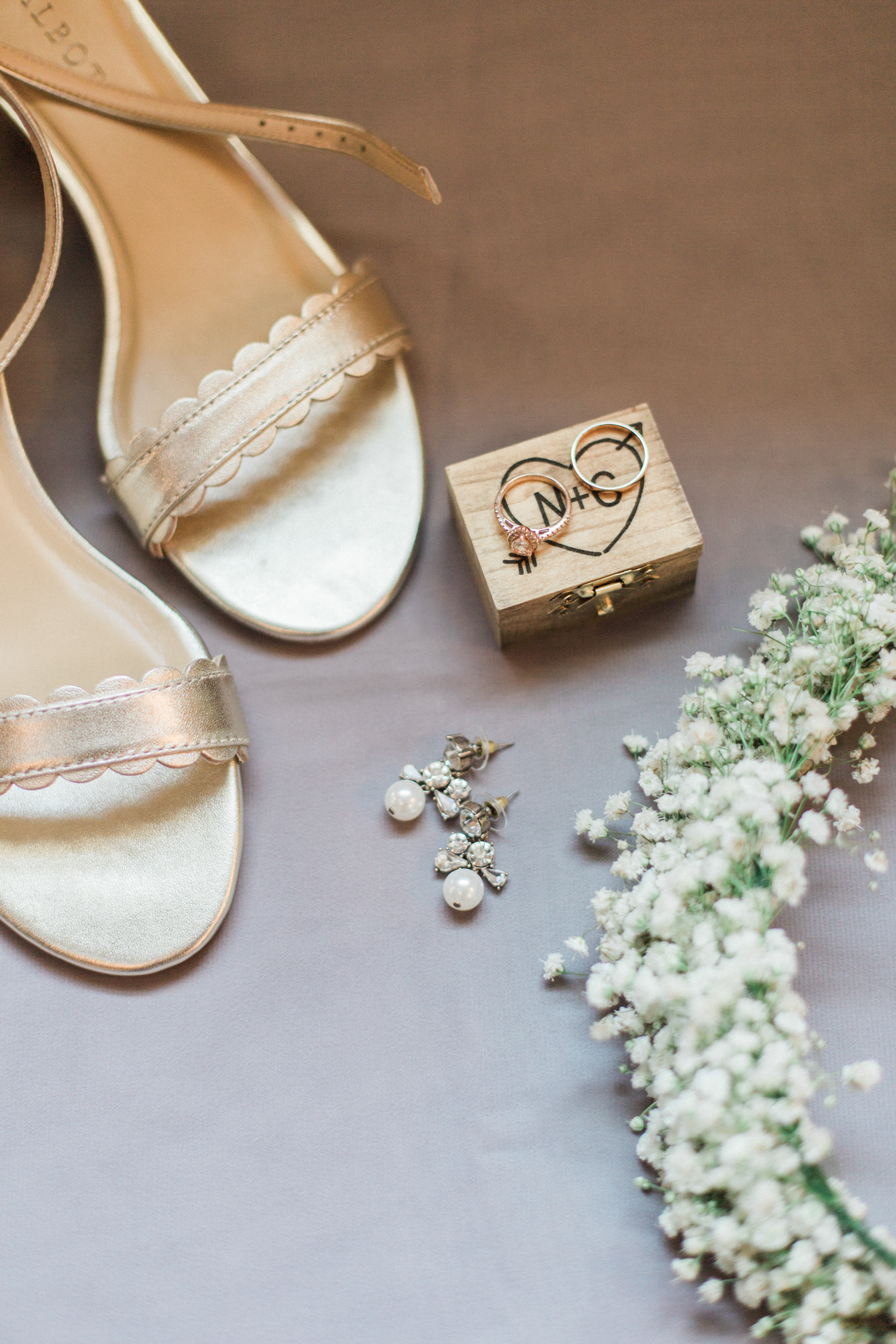 Summer, outdoor, barn wedding in north Georgia at Hays McDonald Farm in Jefferson, Georgia. Photo by Kesia Marie Photography - Fine Art Wedding Photographer. Baby's breath floral crown, and wood burned ring box.