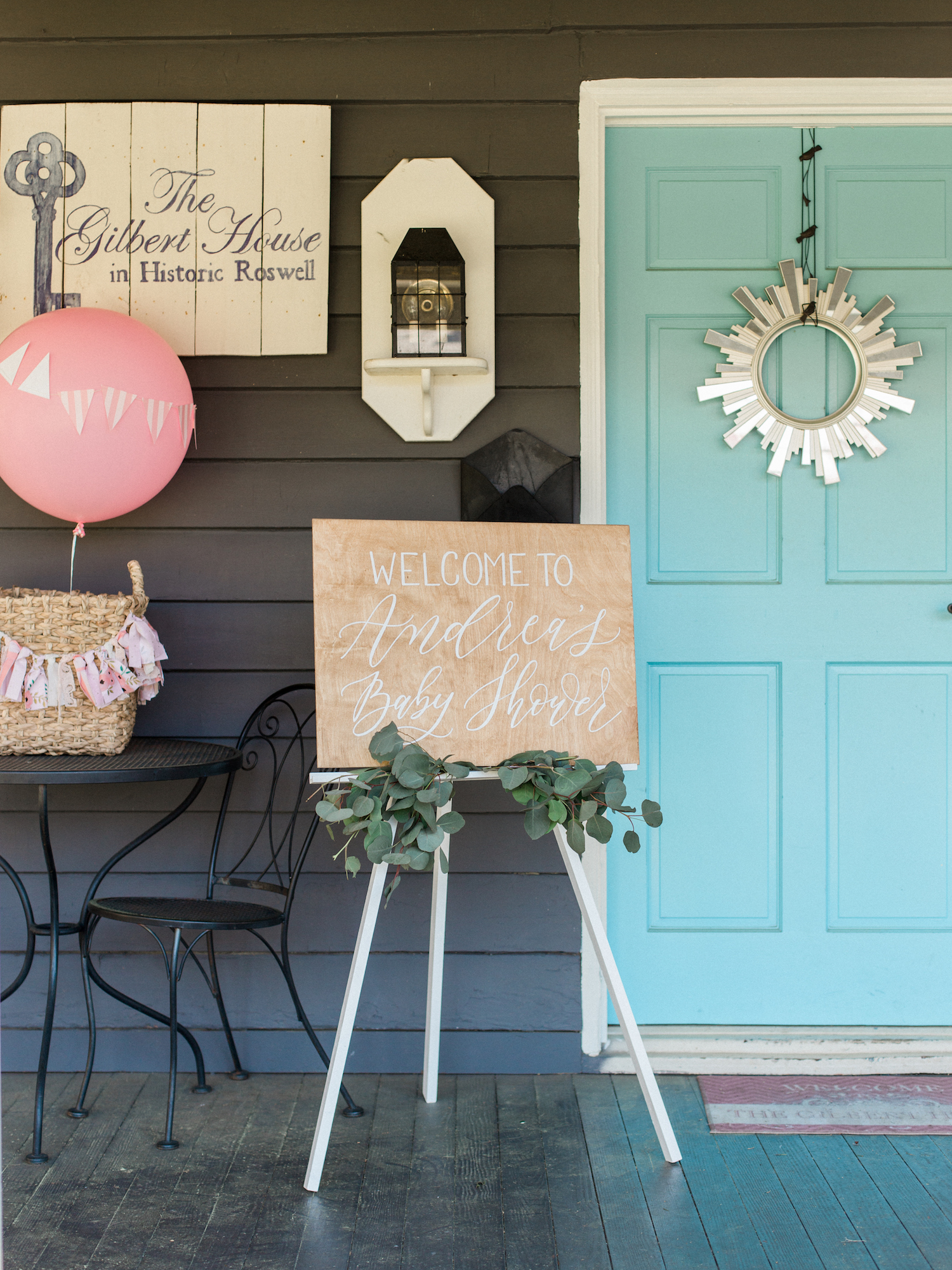 Travel themed spring baby shower at The Gilbert House in Roswell, Georgia. Calligraphy wood sign by ElisaAnne Calligraphy. Photography by Kesia Marie Photography Atlanta Fine Art Event Photographer