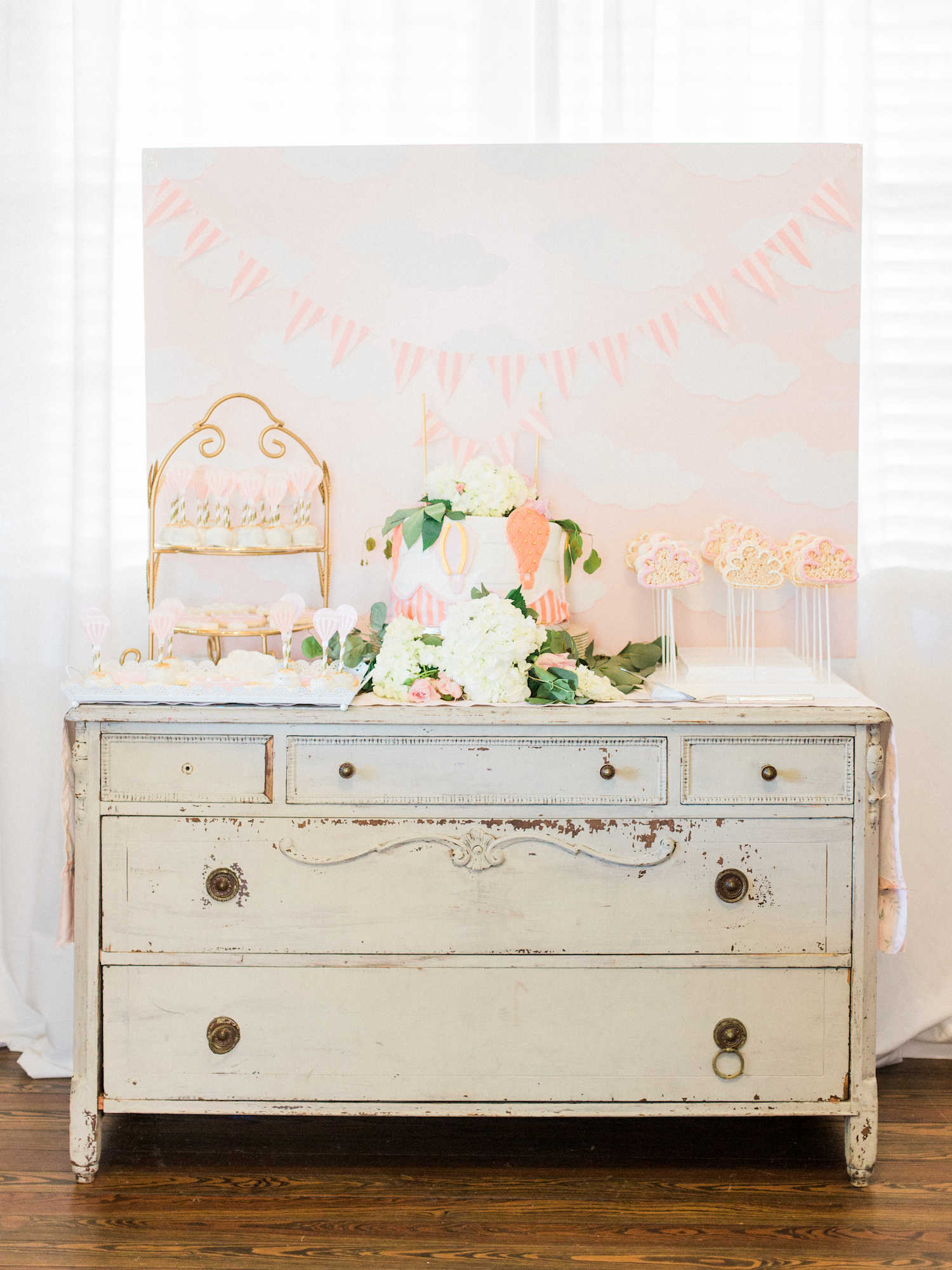 Feminine, travel themed baby shower at The Gilbert House in Roswell, Georgia. Unique desserts and cakes. Hot air balloon decor. Photography by Kesia Marie Photography Atlanta Fine Art Event Photographer