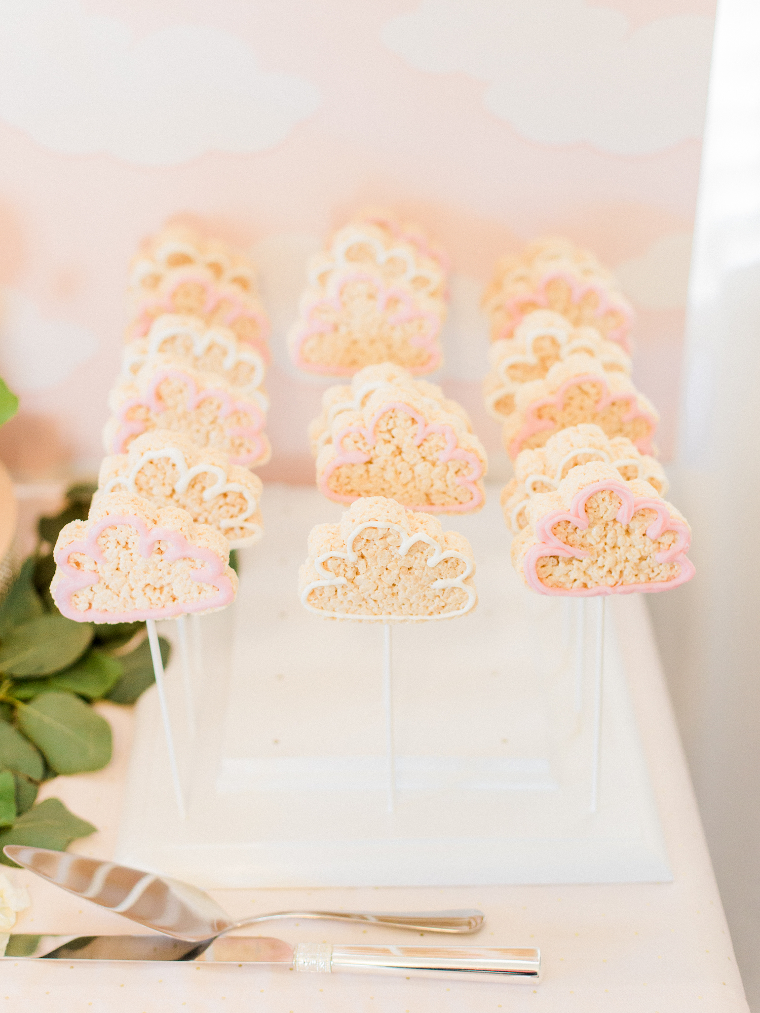 Cloud shaped cookies and rice krispie treats. Travel themed baby shower.