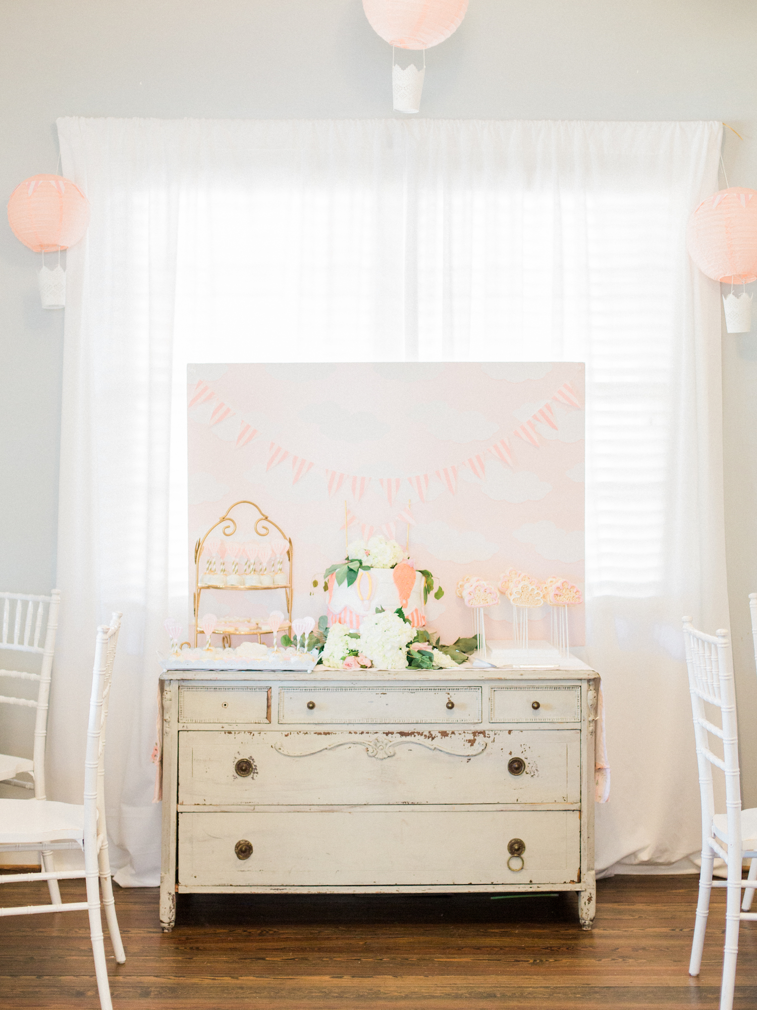 White chiavari chairs. Feminine travel themed baby shower at The Gilbert House with hot air balloon decor, cake, and cookies. Antique event rentals. Baby shower at The Gilbert House. Photography by Kesia Marie Photography Atlanta Fine Art Event Photographer