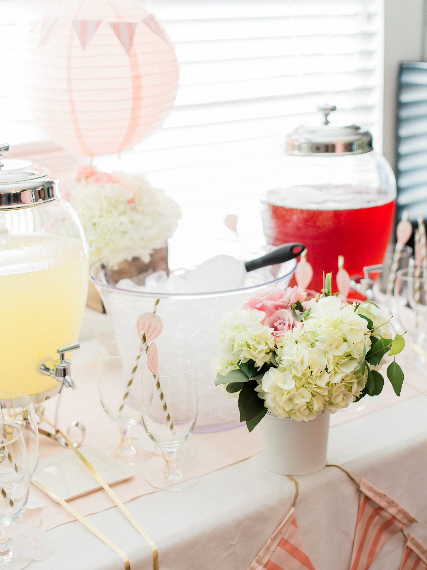 Travel themed baby shower at The Gilbert House. Drink station with hot air balloon decor.