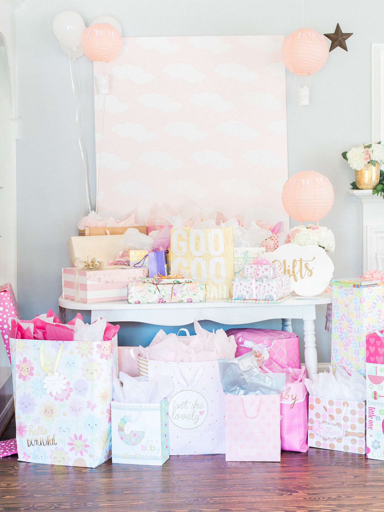 Baby shower gift table and ideas. Travel themed shower at The Gilbert House. Antique event rentals. Hot air balloon decor. Cloud back drop. Photography by Kesia Marie Photography Atlanta Fine Art Event Photographer