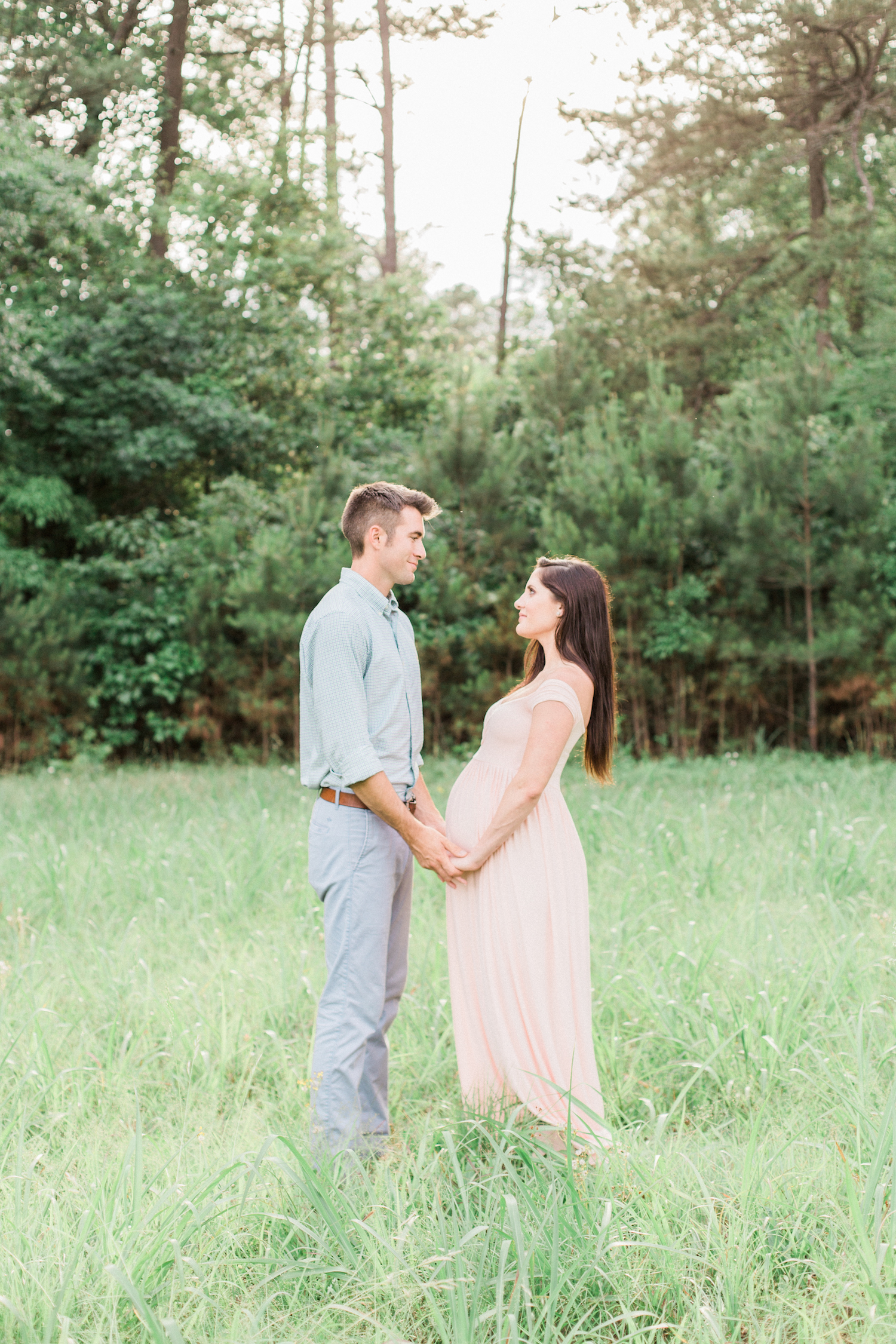 Spring time maternity session with blush pink dress and pastel outfits.