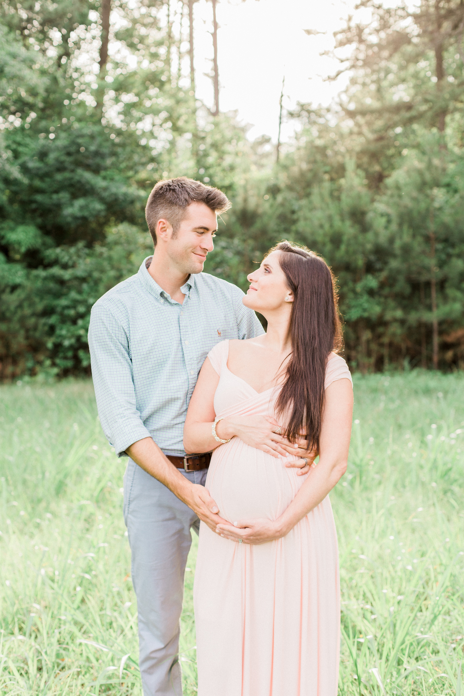 Spring time maternity session outside. Blush pink maternity dress.