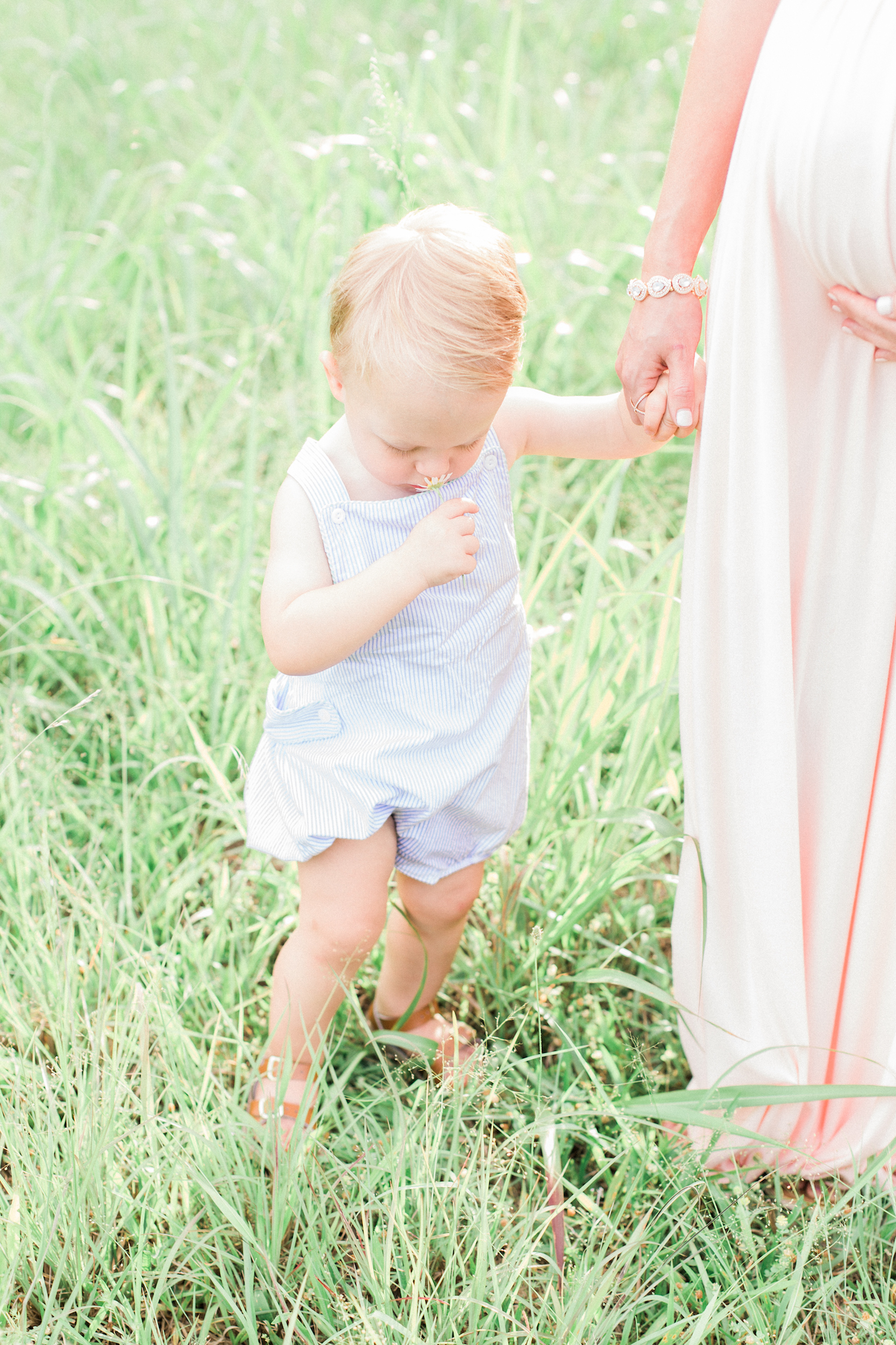 Spring time family session in pastel colored outfits. Childhood photography. Blush pink maternity dress.