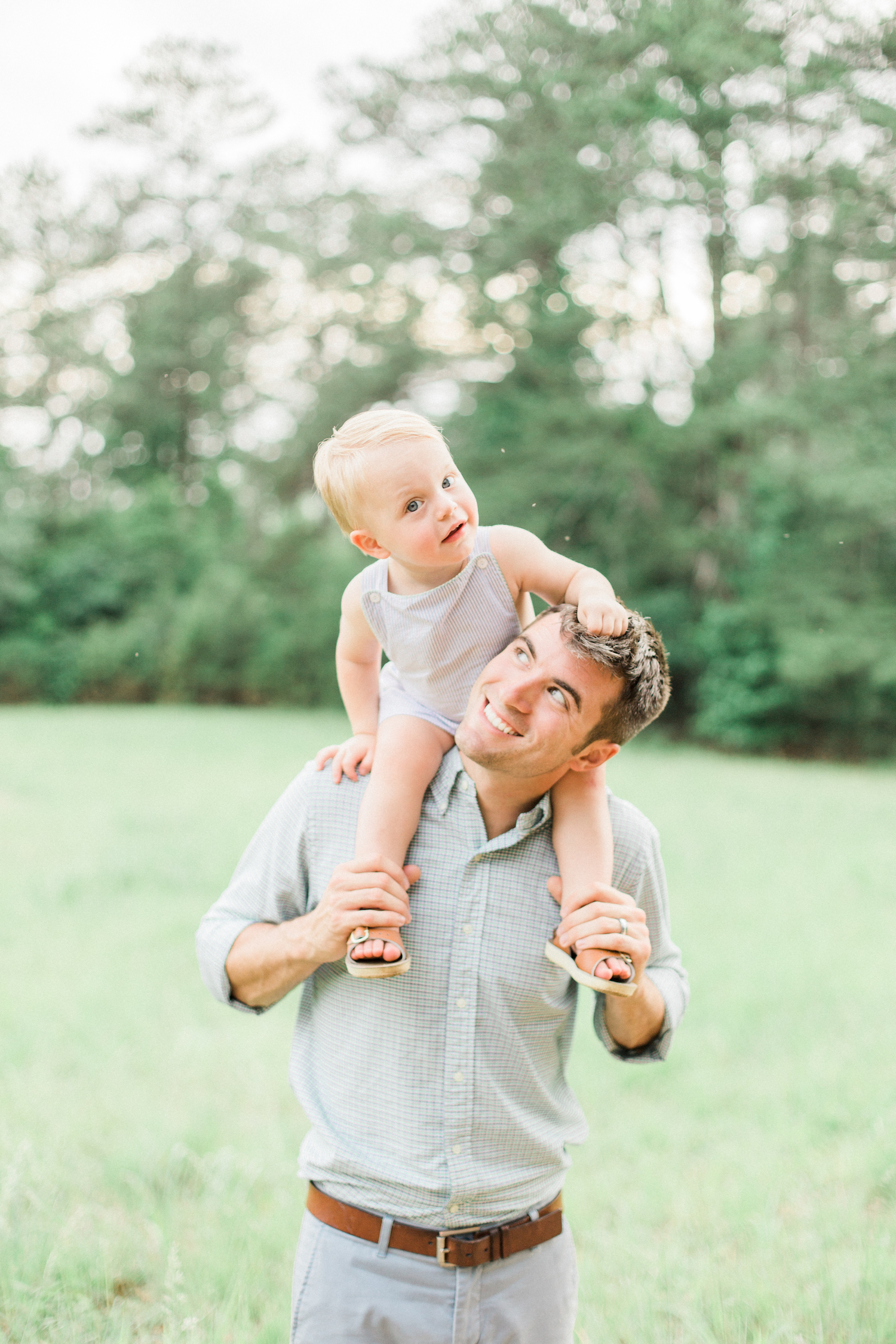 Father and son photo during spring time family session in Atlanta, Georgia. Pastel family photo outfits.