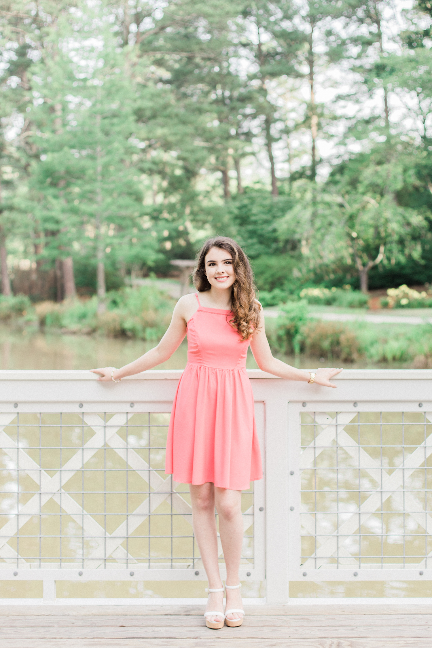 Summer time high school senior session at Vine Mansion Park by Kesia Marie Photography. Featuring feminine, garden details. Senior photos on a white bridge.