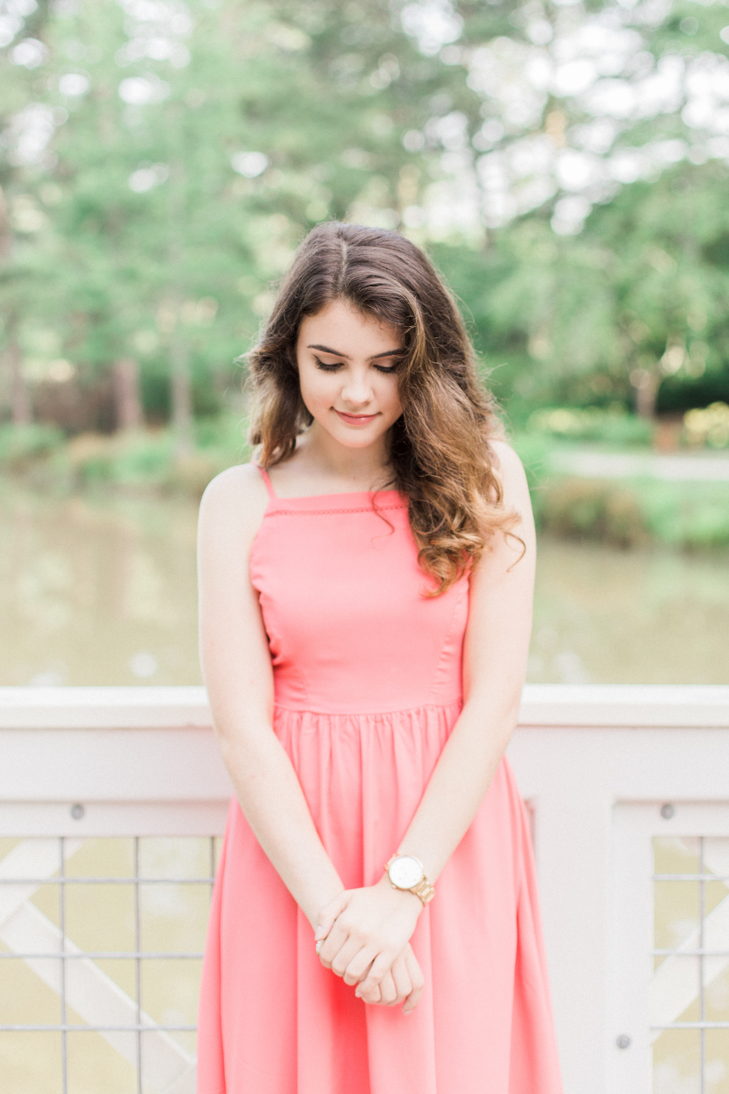 Summer time high school senior session at Vine Mansion Park by Kesia Marie Photography. Featuring feminine, garden details. Senior photos on a white bridge with a pink dress.
