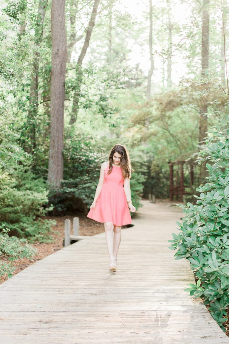 Summer senior session at Vines Mansion Park in Loganville, Georgia by Kesia Marie Photography. Featuring feminine, garden details in gorgeous morning light with adorable pink and floral outfits.