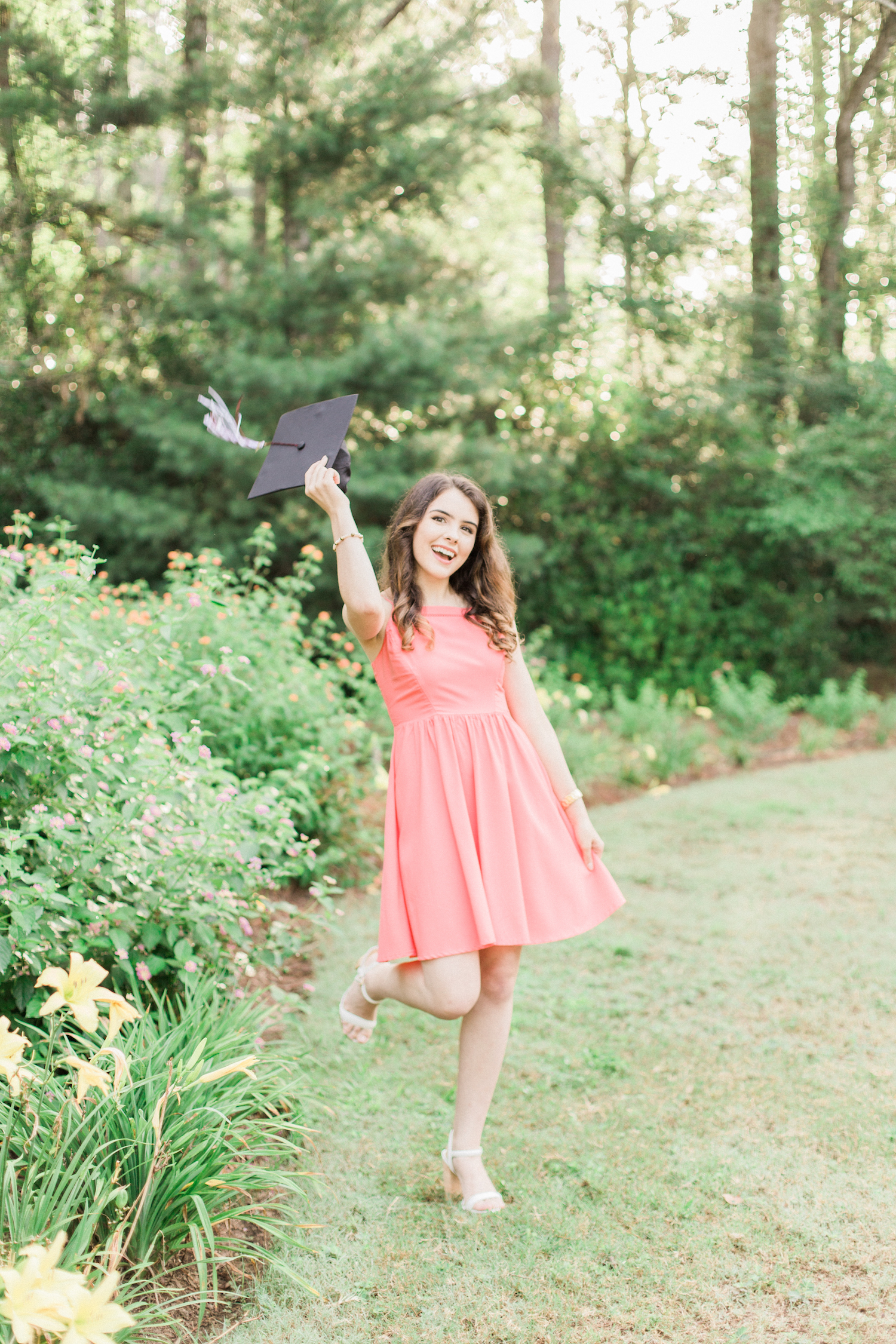 Summer time high school senior session at Vine Mansion Park by Kesia Marie Photography. Featuring feminine, garden details. Senior photos throwing graduation cap.