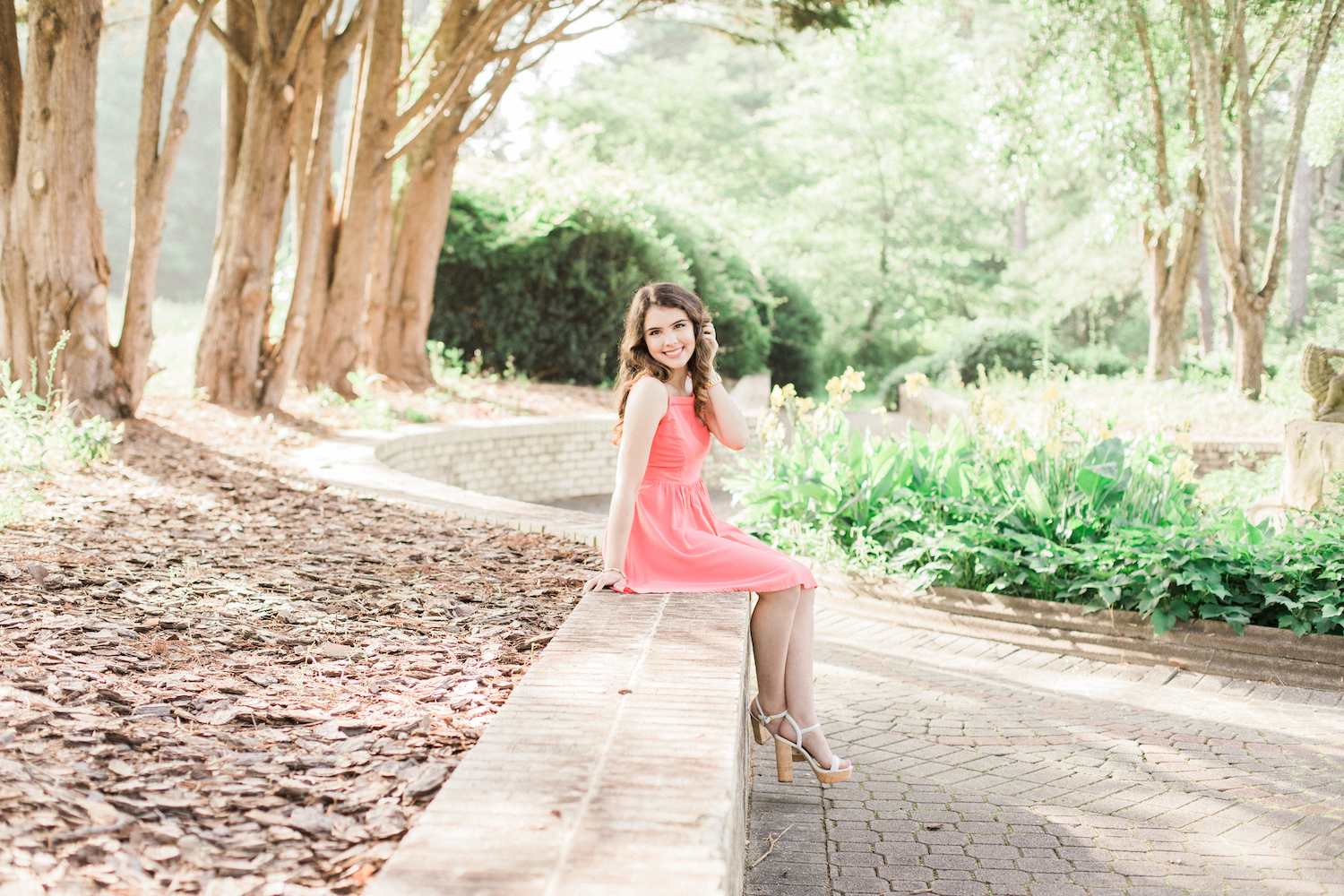 Summer time high school senior session at Vine Mansion Park by Kesia Marie Photography. Featuring feminine, garden details. Senior photos in gorgeous morning light with flowers.
