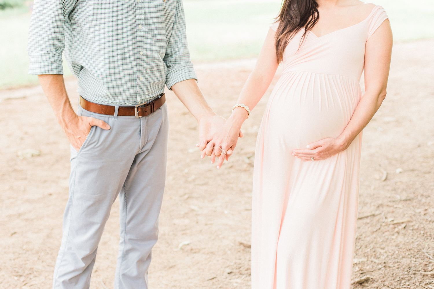 Family session with pastel outfits. Blush maternity dress. Maternity bump.