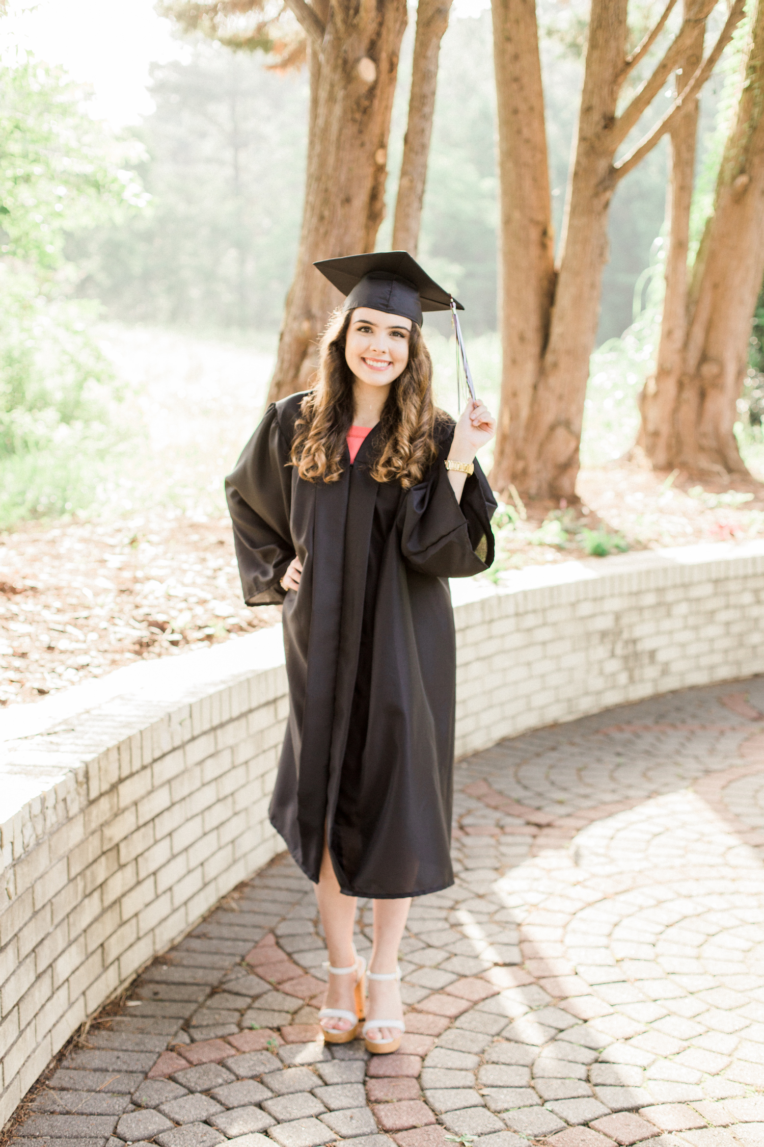 Summer time high school senior session at Vine Mansion Park by Kesia Marie Photography. Featuring feminine, garden details. Senior photos in graduation cap and gown.