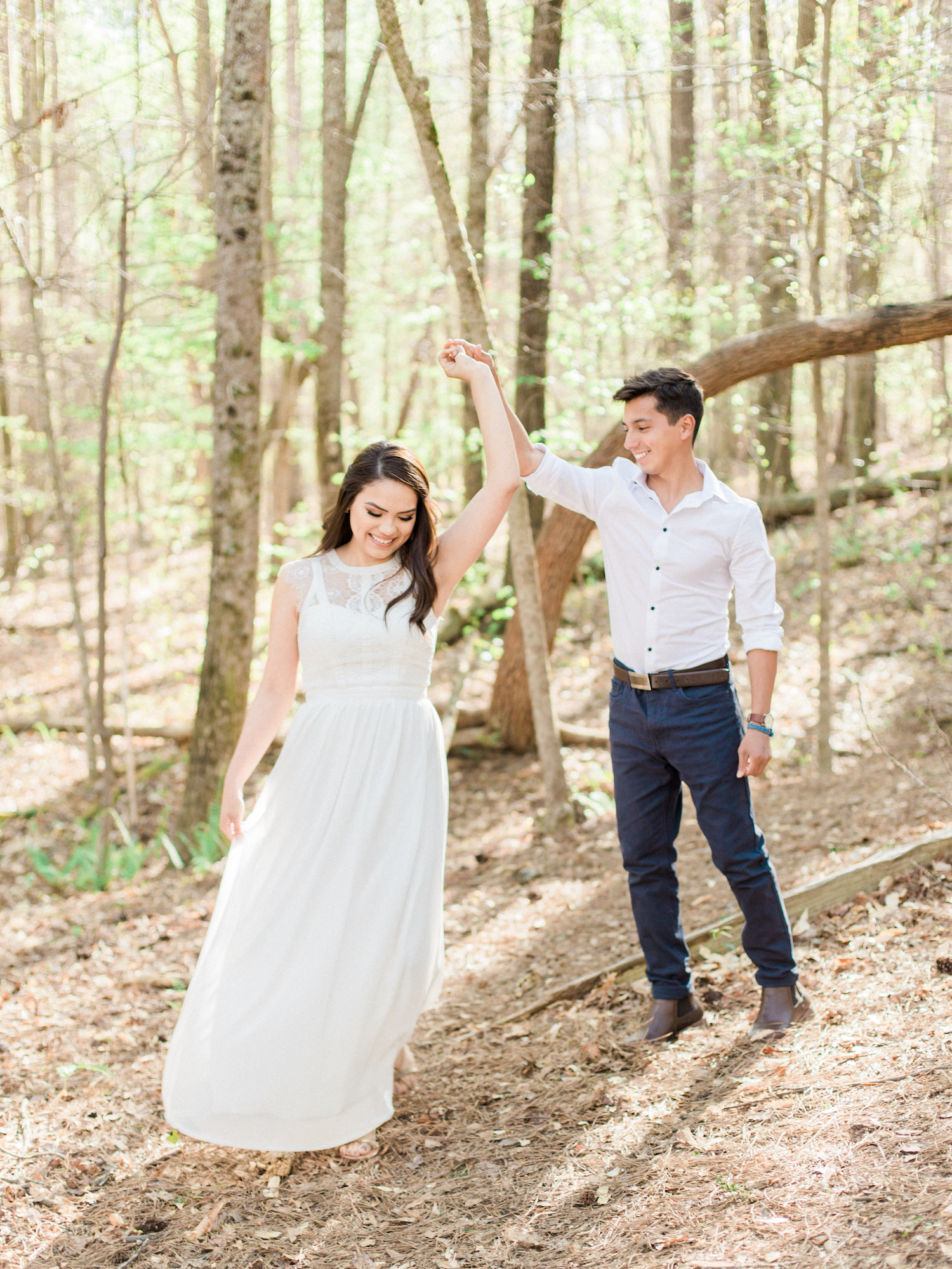 Spring engagement session at Sweetwater Creek State Park in north Georgia. Featuring white, neutral outfits and natural and organic elements.