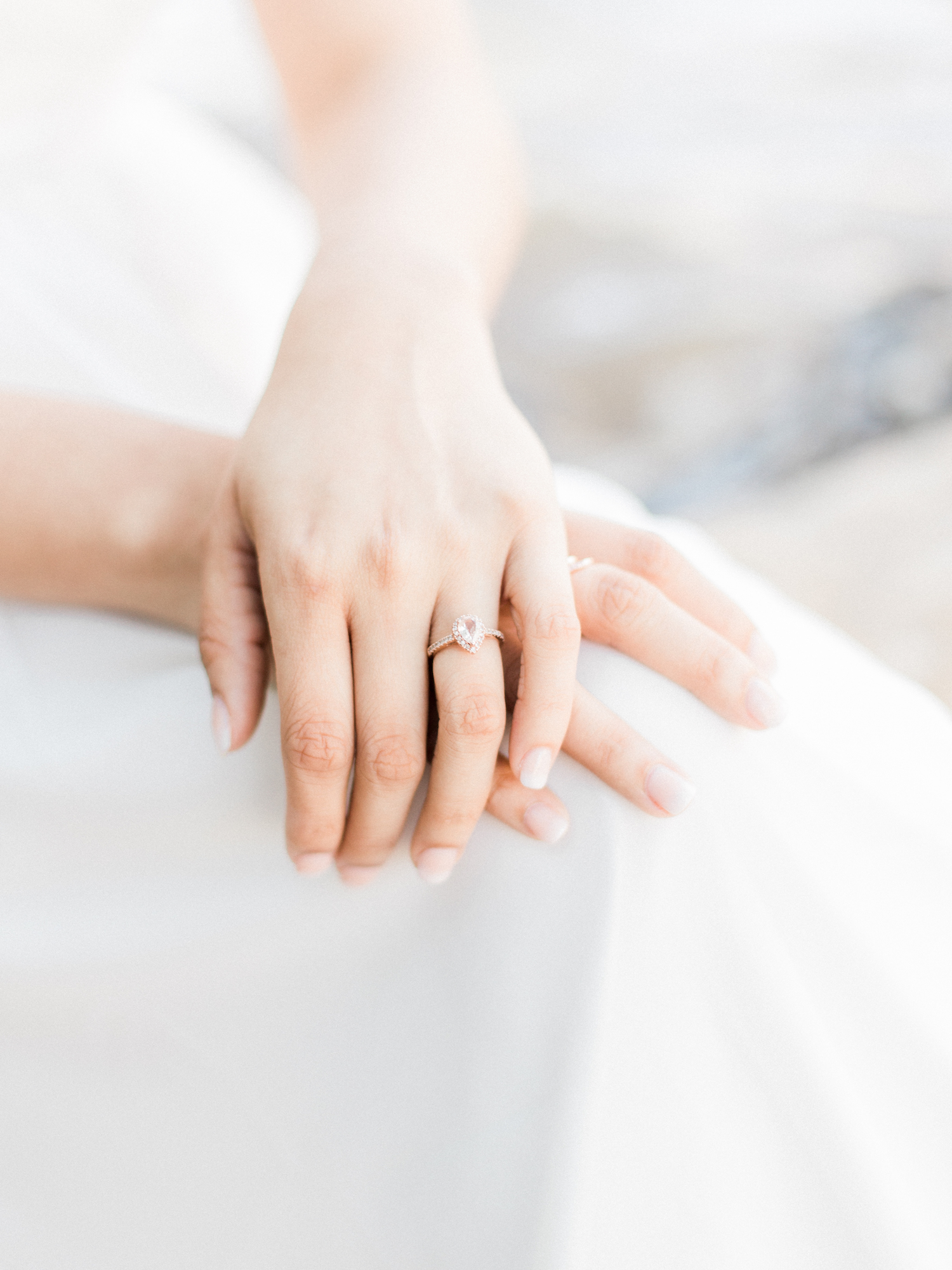 Pear shaped diamond rose gold engagement ring. Spring engagement session at Sweetwater Creek State Park in north Georgia. Featuring white, neutral outfits and natural and organic elements. Photo by Kesia Marie Photography - fine art wedding and portrait photographer in Atlanta, Georgia.