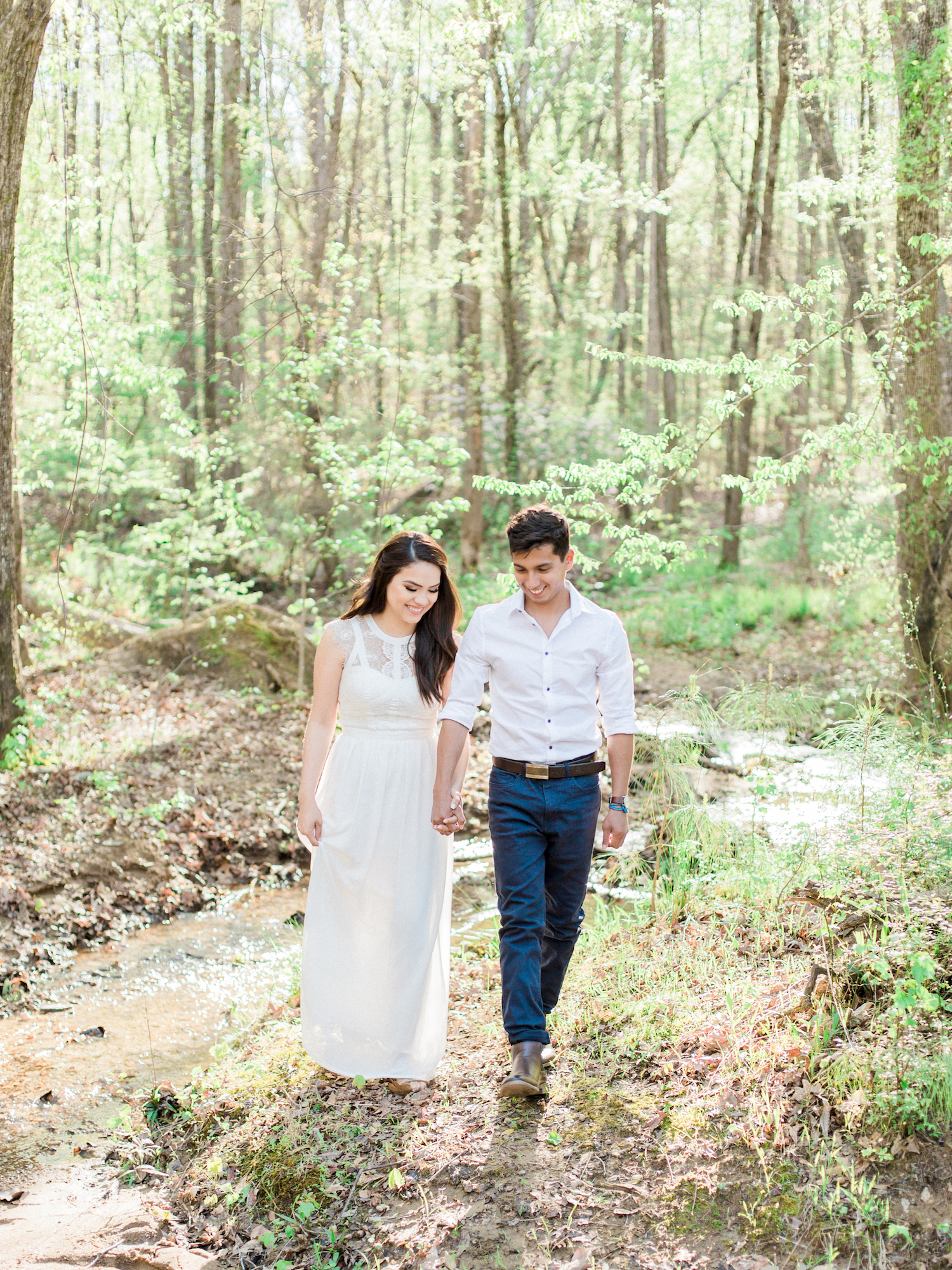 Spring engagement session at Sweetwater Creek State Park in north Georgia. Featuring white, neutral outfits and natural and organic elements. Photo by Kesia Marie Photography - fine art wedding and portrait photographer in Atlanta, Georgia.